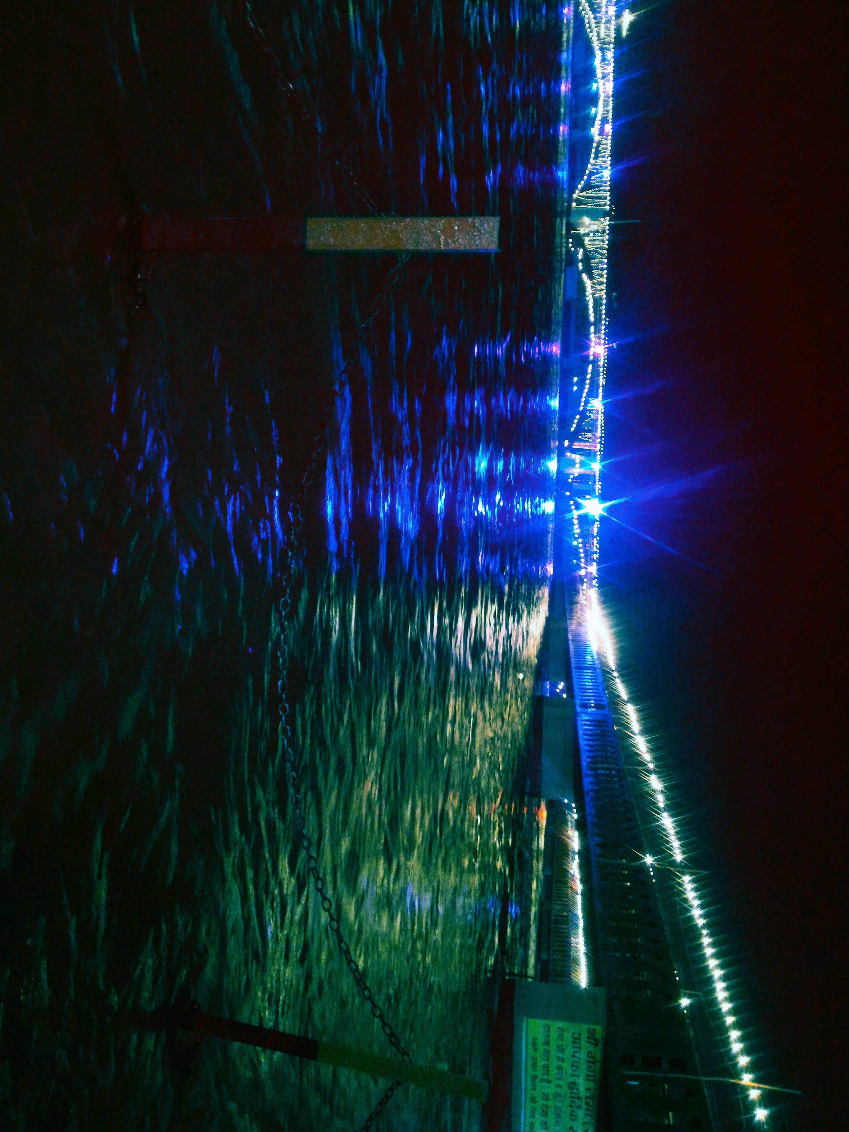 night, illuminated, water, long exposure, motion, glowing, light - natural phenomenon, blurred motion, blue, outdoors, reflection, light trail, sky, lighting equipment, light, sparks, one person, speed, nature