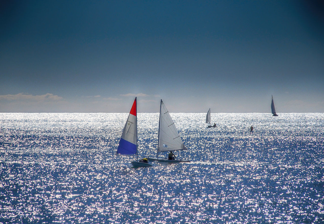 Mediterranean sea in Barcelona - Catalunya Beauty In Nature Blue Boat Canvas Copy Space Day Horizon Over Water Journey Mode Of Transport Nature Nautical Vessel Outdoors Sail Sailboat Sailing Sailing Boat Scenics Sea Seascape Sky Tranquil Scene Tranquility Transportation Water Waterfront