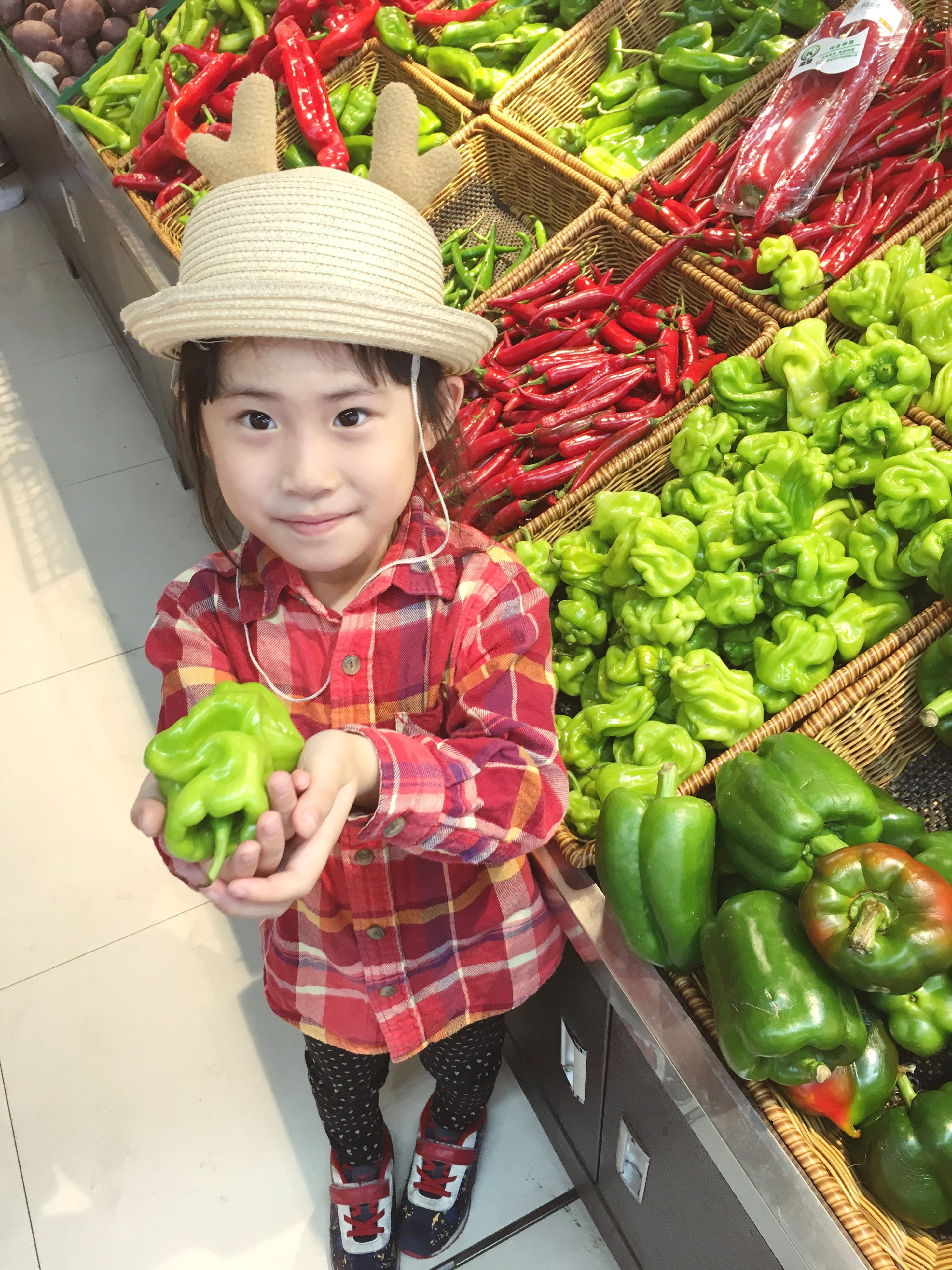 real people, looking at camera, portrait, vegetable, childhood, food and drink, elementary age, hat, one person, smiling, lifestyles, red, cute, food, front view, day, boys, happiness, leisure activity, fruit, outdoors, freshness, healthy eating