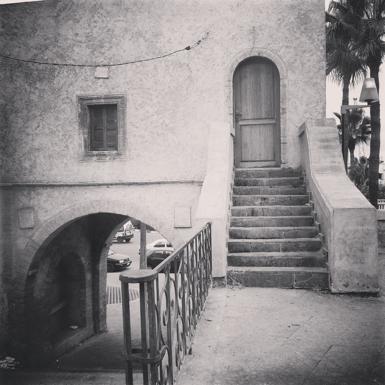 steps, architecture, railing, built structure, building exterior, window, steps and staircases, staircase, entrance, outdoors, facade, arch, stairs, day, the way forward, history, outside, balustrade, leading, stone material, architectural column, railings