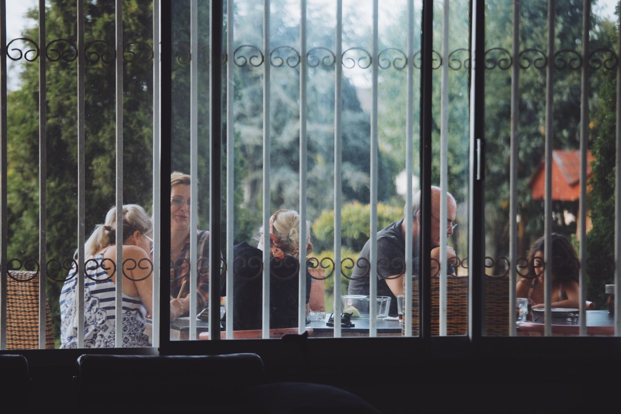 window, reflection, real people, day, looking through window, built structure, women, men, indoors, tree, people