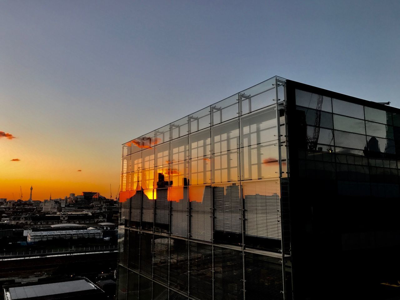 architecture, sunset, built structure, clear sky, building exterior, no people, sky, outdoors, city, day