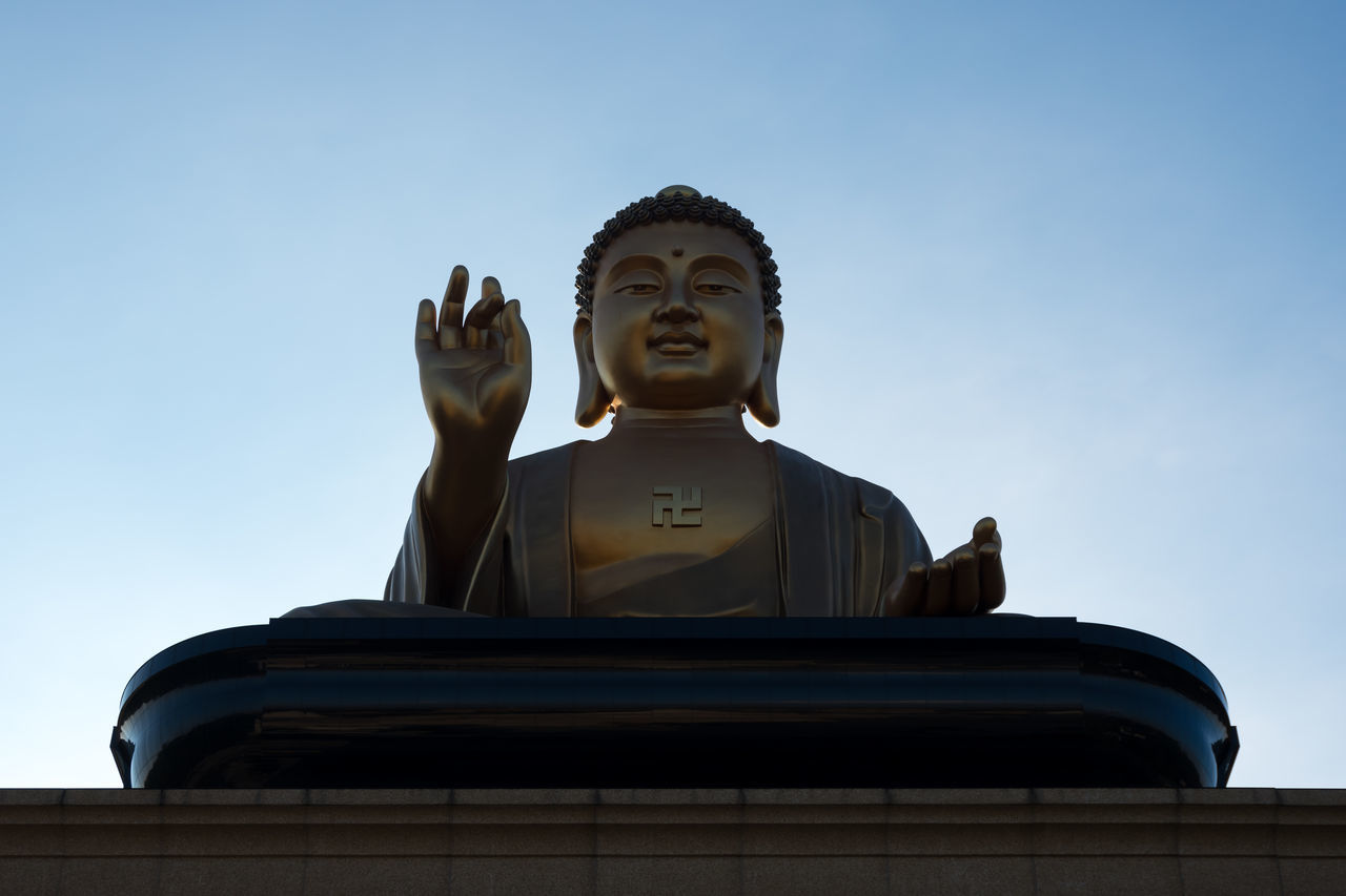 Low angle view of big Buddha statue at the Fo Guang Shan Monastery in Kaohsiung, Taiwan. BIG Buddha Buddha Statue Buddhism Buddhist Chinese Clear Sky Fo Guang Shan Huge Human Representation Idol Large Low Angle View Meditating Meditation Religion Sculpture Seated Sitting Sky Spirituality Statue Taiwan Temple Traditional