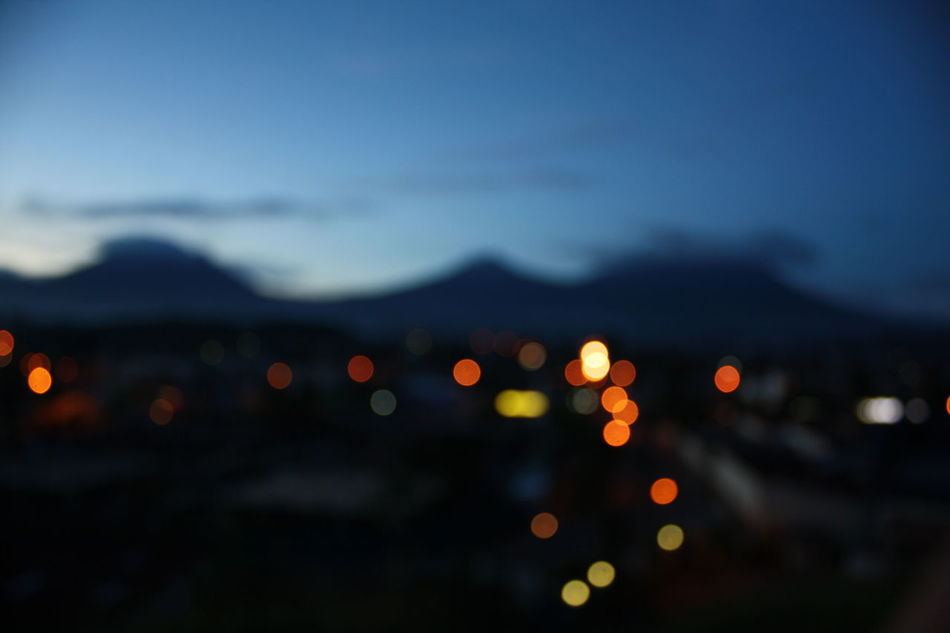 Lights over Rwanda Night Defocused Illuminated Sky Nature Mountain Scenics EyeEmNewHere Africa Rwanda Volcano Lights Bokeh The City Light Welcome To Black
