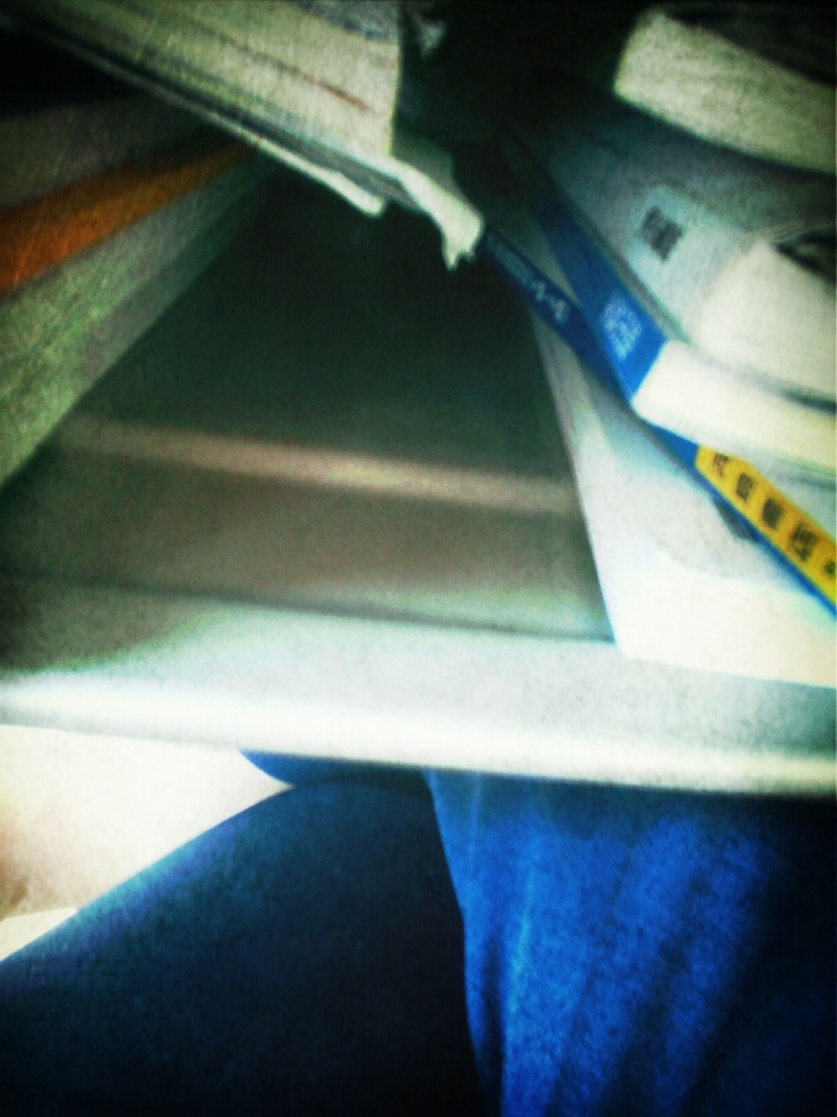 indoors, transportation, close-up, part of, mode of transport, vehicle interior, high angle view, blue, cropped, paper, book, no people, technology, pen, education, detail, selective focus, travel, day, vehicle seat