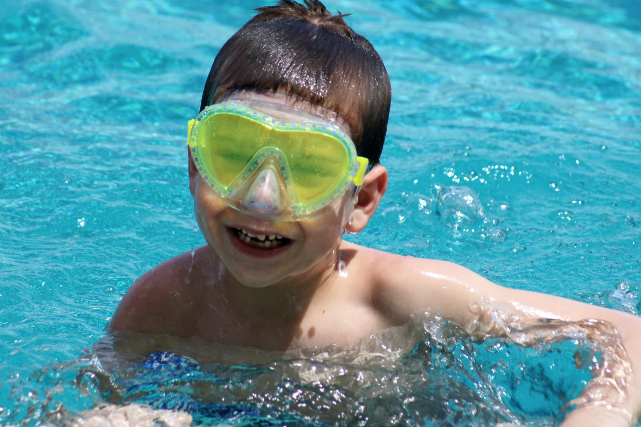 Fun in the Sun Boys Child Childhood Children Children Only Day Elementary Age Fun Happiness Headshot Leisure Activity One Boy Only One Person Outdoors Pool Shirtless Summer Summer Fun Summerime Swimming Swimming Swimming Goggles Swimming Pool Swings Water