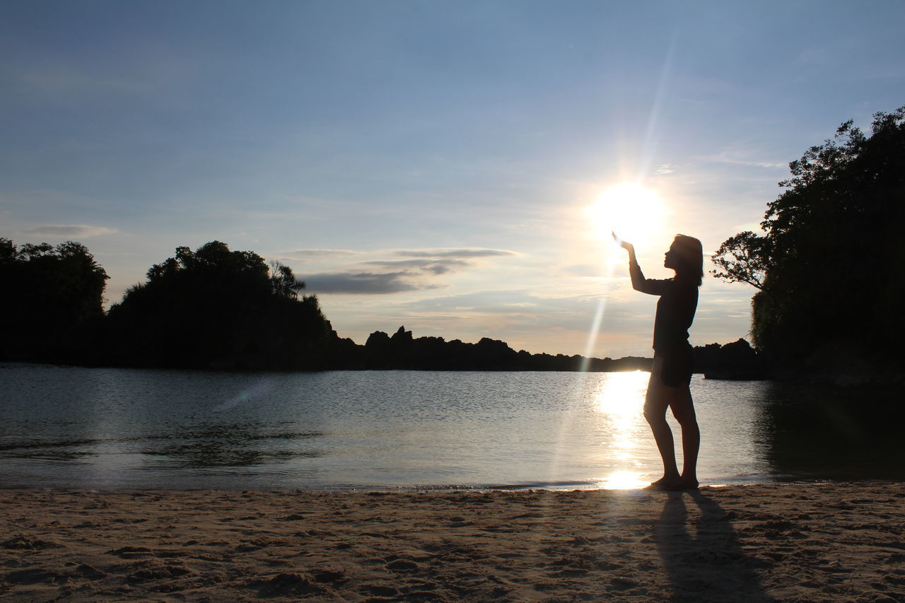 Lake Sunset Nature Sunlight Child Photography Themes Vacations One Woman Only Beauty In Nature Sunbeam Silhouette Full Length Technology Sport Outdoors Women Sky Adventure Adult Water