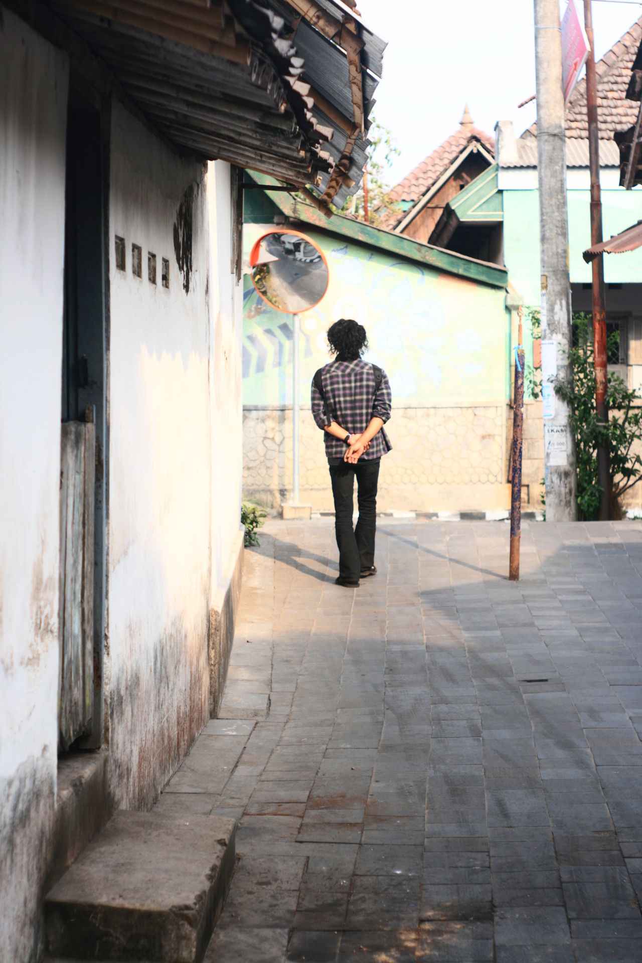Adult Architecture Authentic Building Exterior Built Structure City Culture Day Full Length Lifestyles Men One Person Outdoors People Real People Rear View Standing Street Street Village Yogyakarta