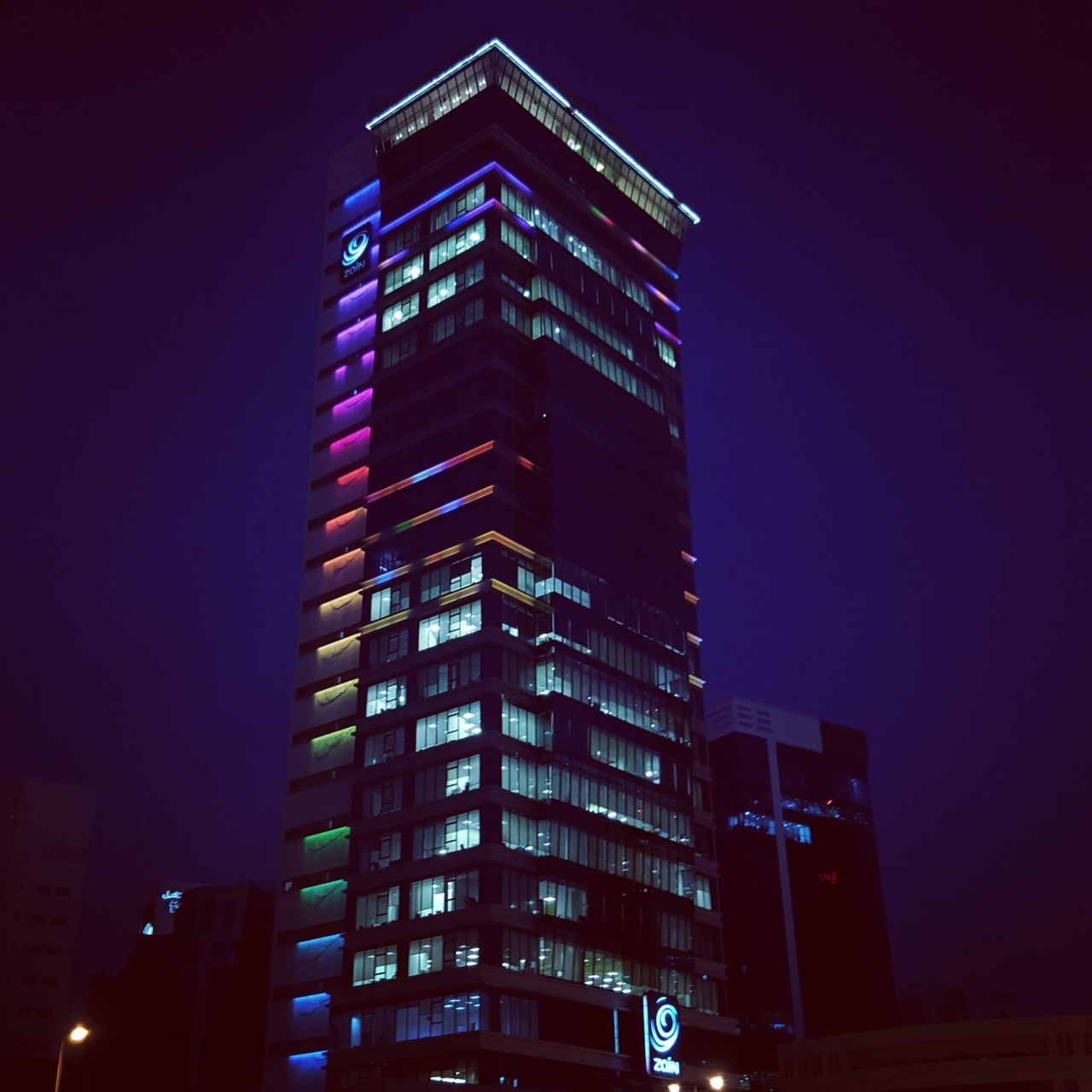 Skyscraper Finance And Economy Night Architecture Business Finance And Industry Modern City Built Structure Building Exterior Illuminated Low Angle View Cityscape Downtown District Urban Skyline Outdoors Neon Business Dubai Philippines Thailand Bahrain Bahrainlife DXB Travel Future