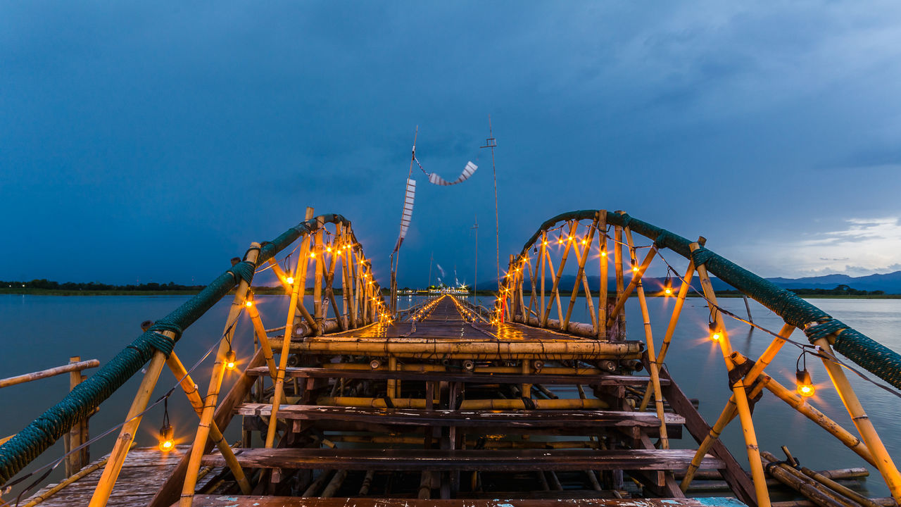 PHAYAO, THAILAND - JULY 19, 2016: The bamboo bridge, The bamboo bridge of Wat Ti Lok Aram temple in kwan phayao off freshwater lake of Thailand. Day is the important Buddhist. Architecture ASIA Bamboo Bridge Blue Bridge - Man Made Structure Buddhist Built Structure Capital Cities  Connection Engineering Famous Place Illuminated Important International Landmark Kwan Phayao Low Angle View Night Outdoors Sky Suspension Bridge Temple Thailand Tourism Travel Destinations Wat Ti Lok Aram
