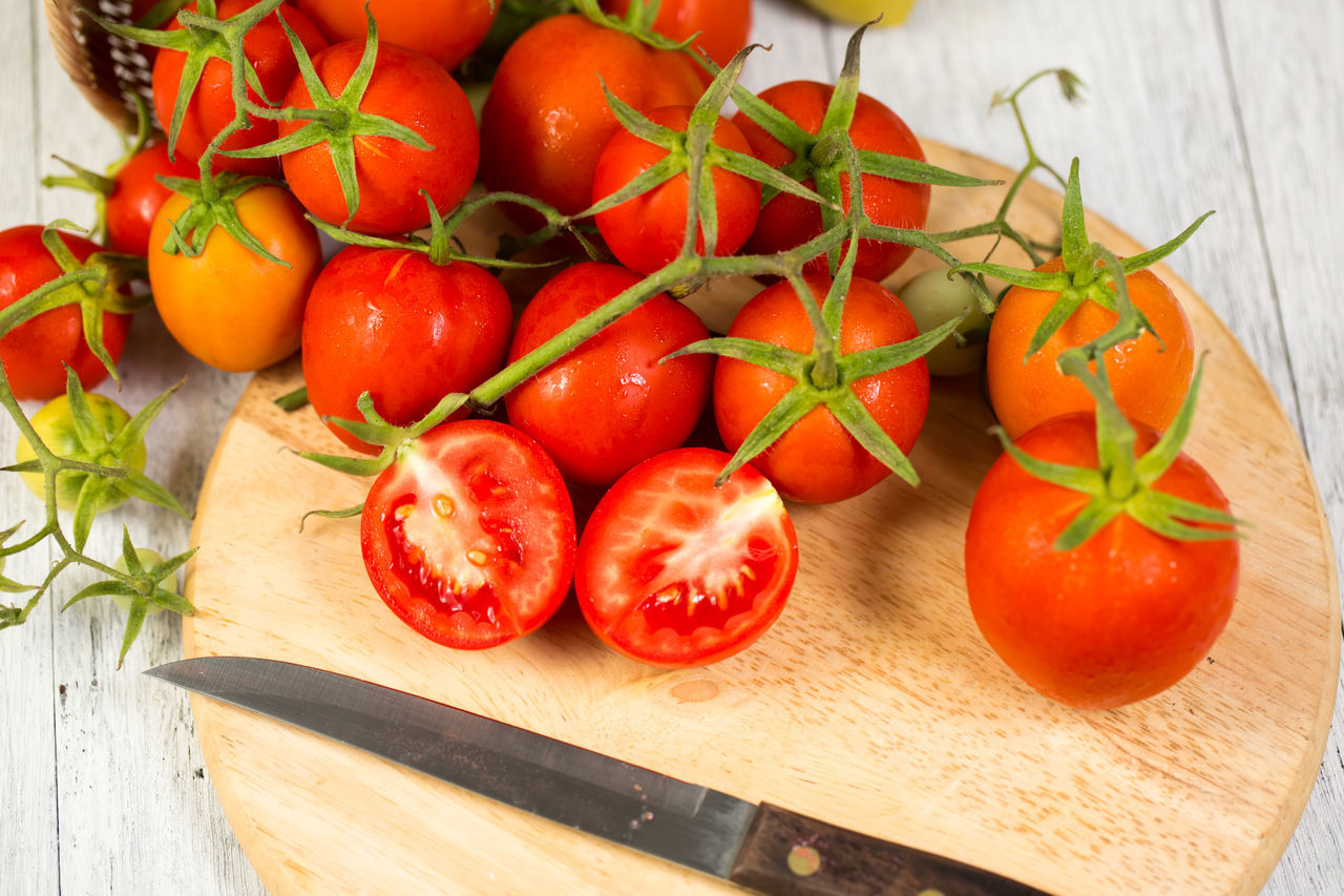 vegetable, food and drink, tomato, food, red, freshness, healthy eating, table, no people, high angle view, wood - material, cutting board, day, indoors, close-up