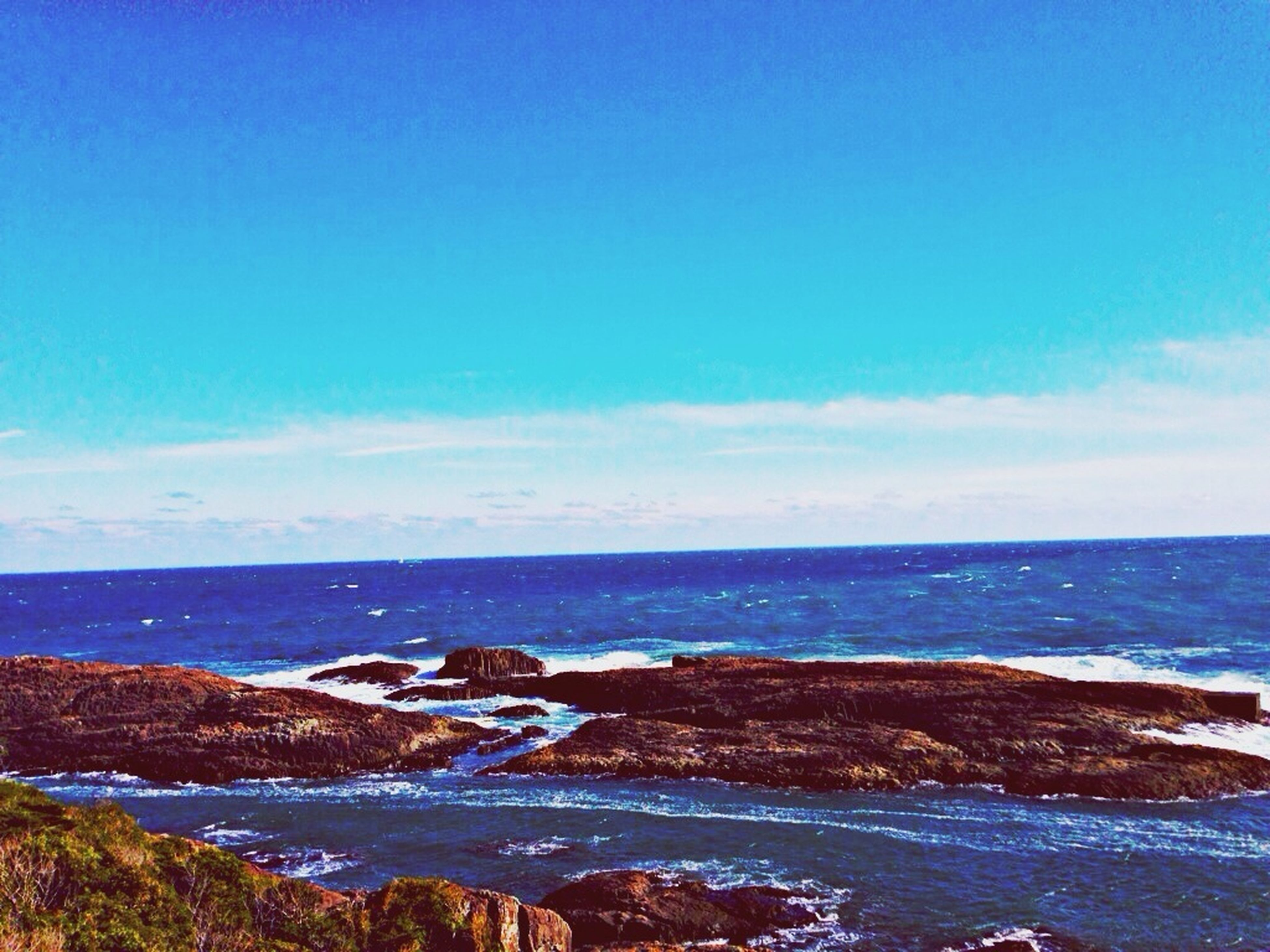 sea, horizon over water, water, scenics, sky, blue, tranquil scene, beauty in nature, tranquility, beach, nature, shore, idyllic, cloud - sky, rock - object, cloud, coastline, outdoors, seascape, wave