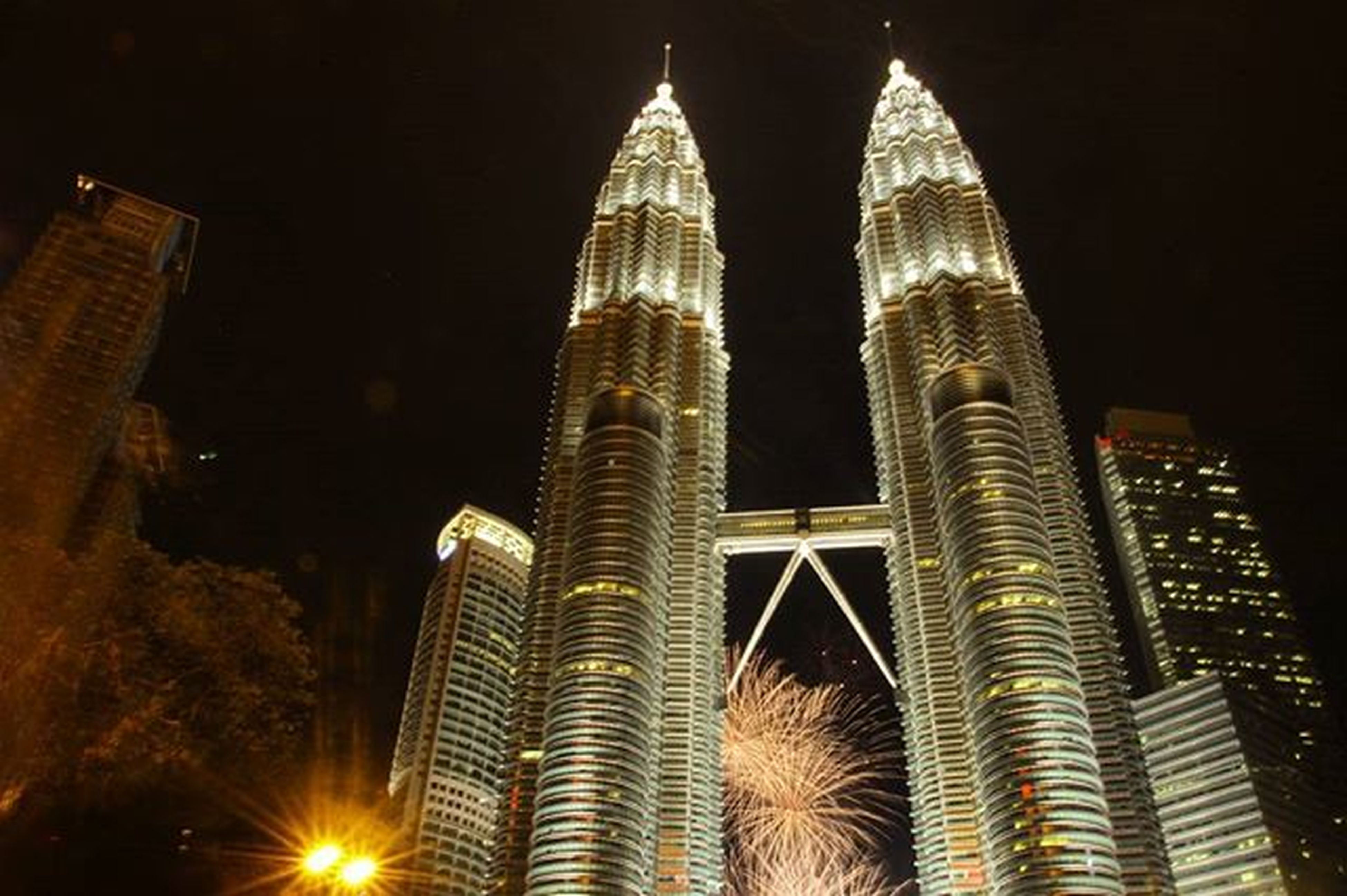 architecture, night, building exterior, built structure, skyscraper, illuminated, tall - high, city, low angle view, tower, modern, office building, travel destinations, famous place, capital cities, international landmark, tourism, sky, outdoors, tall