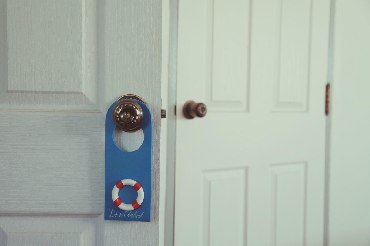 Do Not Disturb Sign On Doorknob At Home
