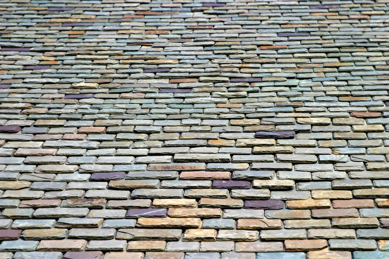 Roof Tiles Colorful stone roof tiles from below. Abstract Architecture Background Backgrounds Blue Brown Building Design Detail Home House Material Old Pattern Protection Red Roof Roofing Stone Structure Texture Tile Tiled Tiles Top