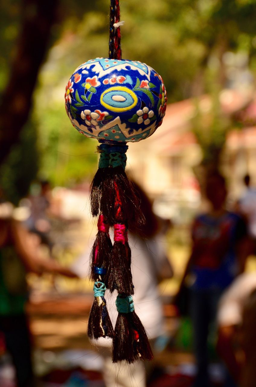 hanging, focus on foreground, multi colored, outdoors, celebration, day, close-up, no people