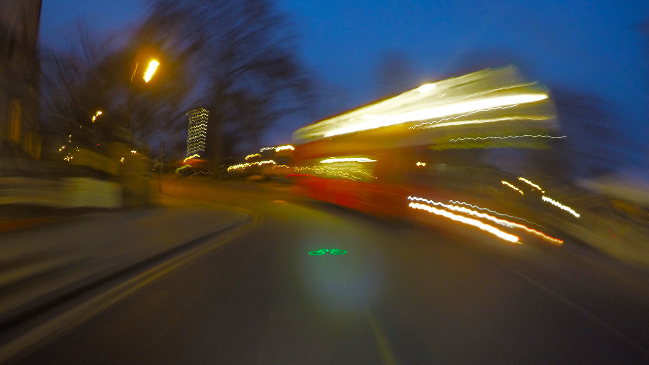 illuminated, speed, no people, blurred motion, transportation, night, sky, outdoors, architecture, city