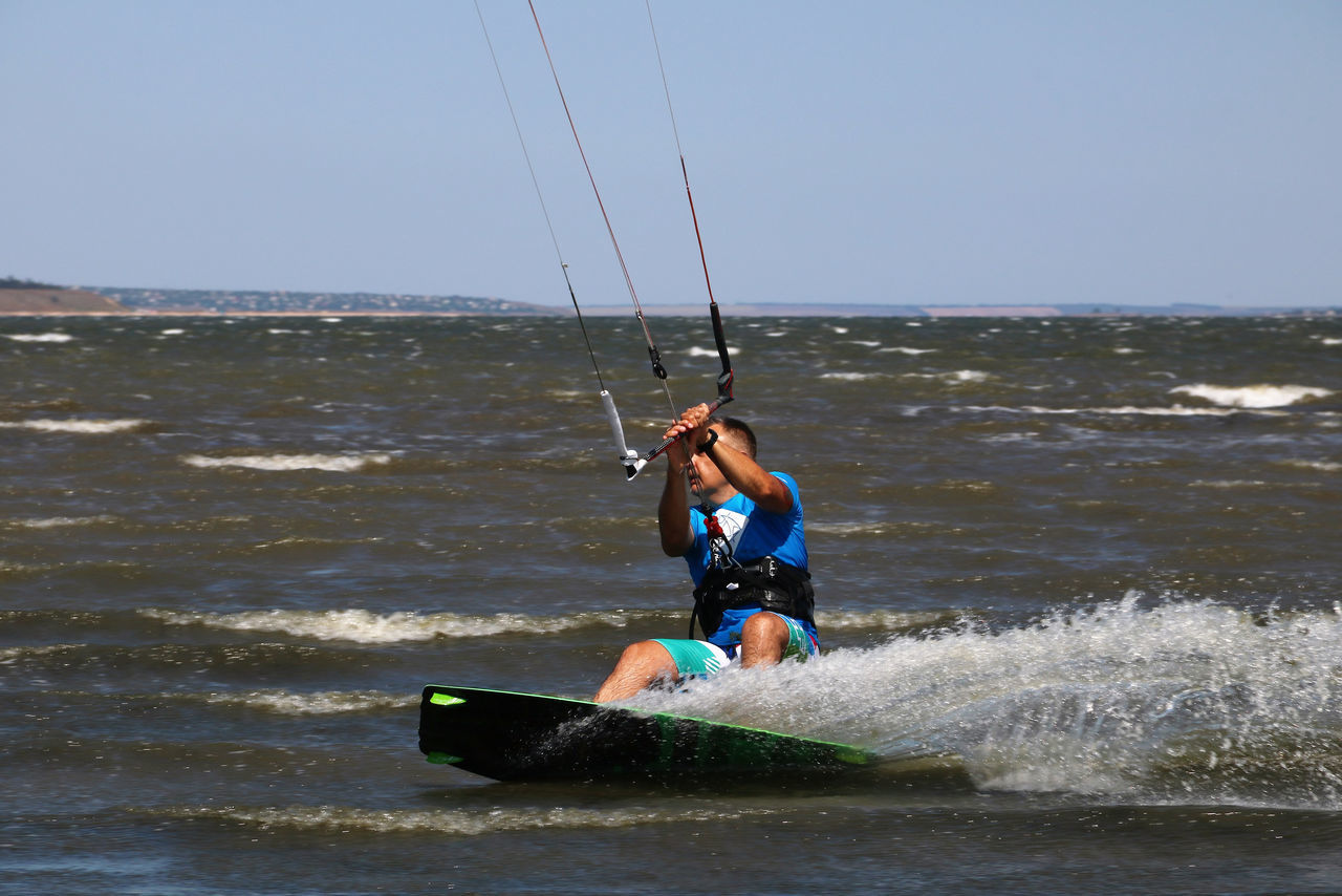 Beauty In Nature Day Enjoyment Extreme Sports Full Length Fun Horizon Over Water Kitesurfing Leisure Activity Lifestyles Nature Outdoors Rippled Scenics Scud Sea Sky Speed Splash Tranquil Scene Tranquility Vacations Water Sport