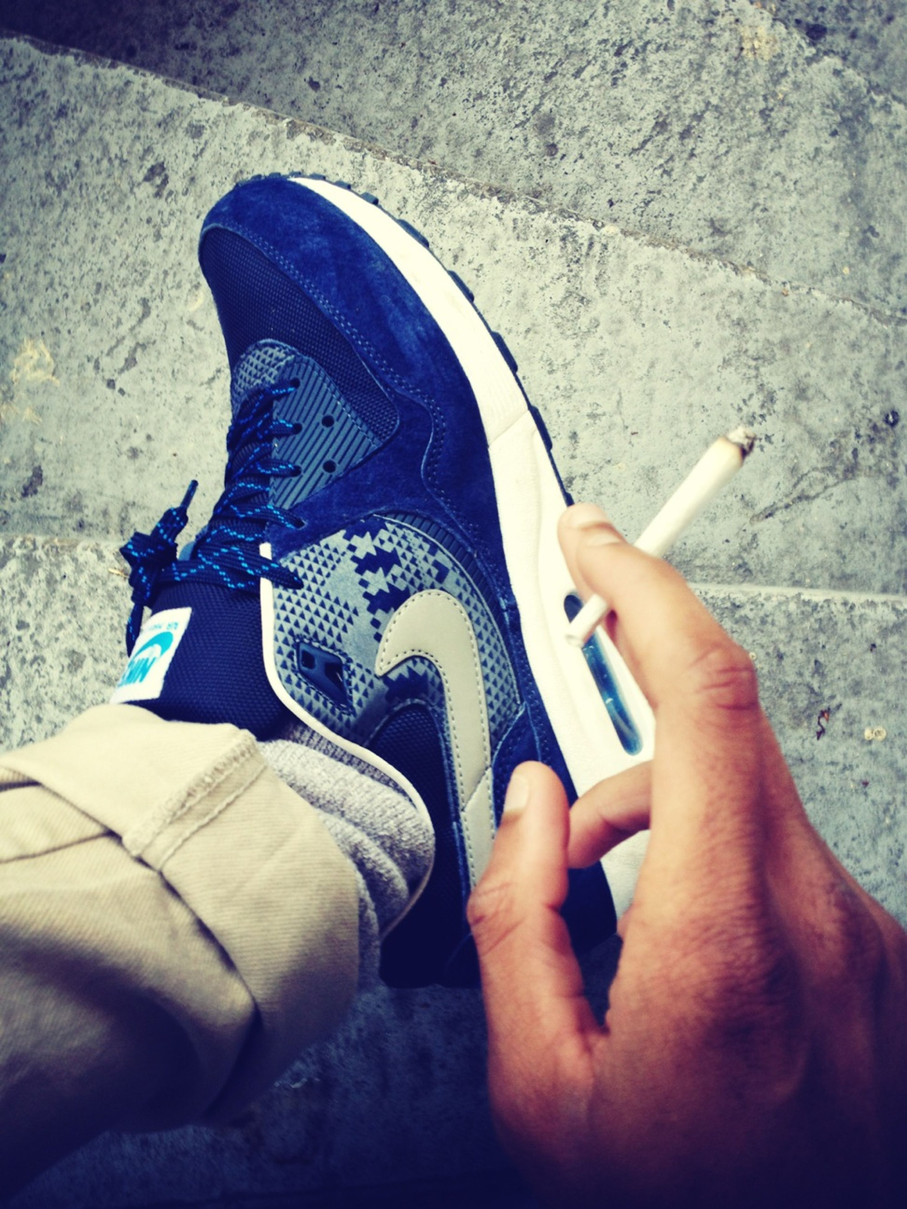 person, part of, personal perspective, low section, lifestyles, shoe, leisure activity, men, close-up, holding, cropped, footwear, human finger, unrecognizable person, human foot, high angle view