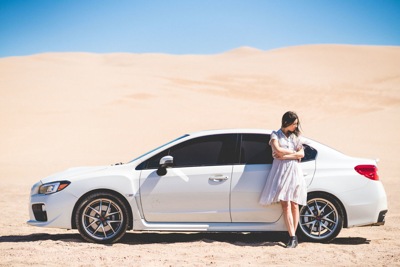 White on white Desert Sand Transportation Arid Climate Travel Outdoors Car Clear Sky Sand Dune Day One Woman Only Women Young Adult One Person Subaru Showcase: March Beauty In Nature Scenics California