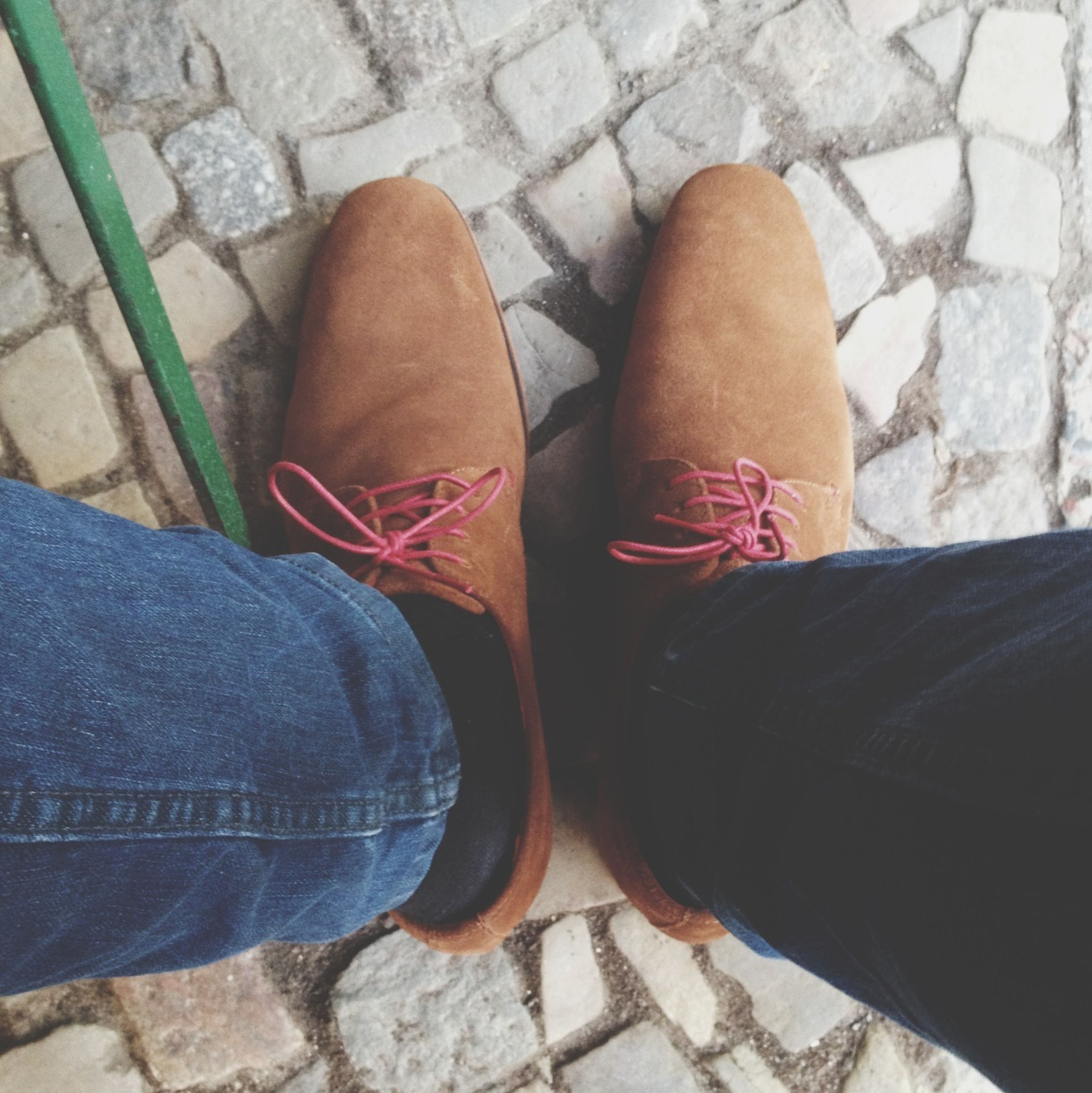 low section, person, shoe, personal perspective, footwear, human foot, high angle view, jeans, standing, lifestyles, directly above, canvas shoe, leisure activity, men, pair, unrecognizable person