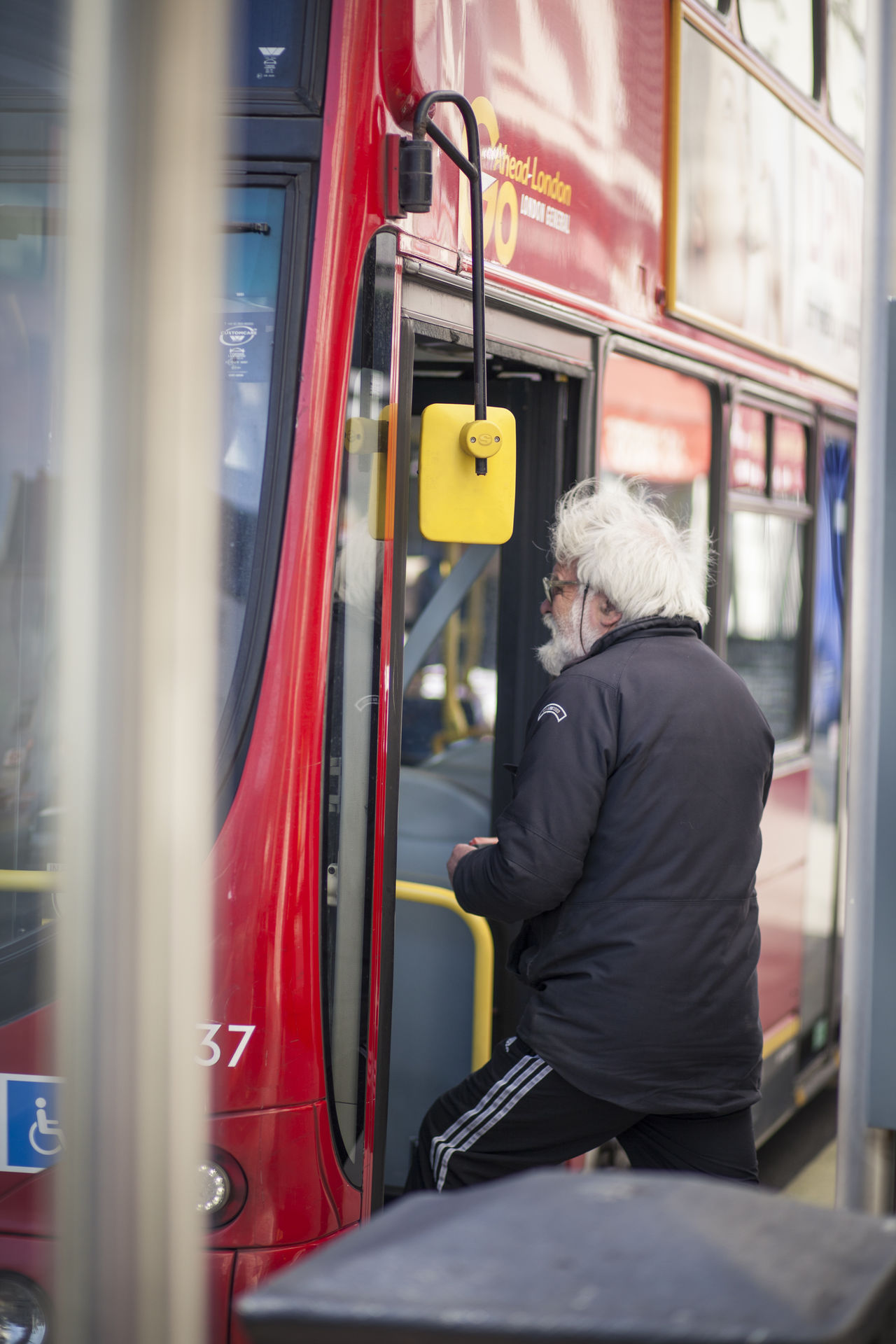 Adult Adults Only Bus Stop City Day London Lifestyle One Man Only One Person Only Men Outdoors Overcoat Passenger People Public Transportation Sitting Subway Train Train - Vehicle Warm Clothing
