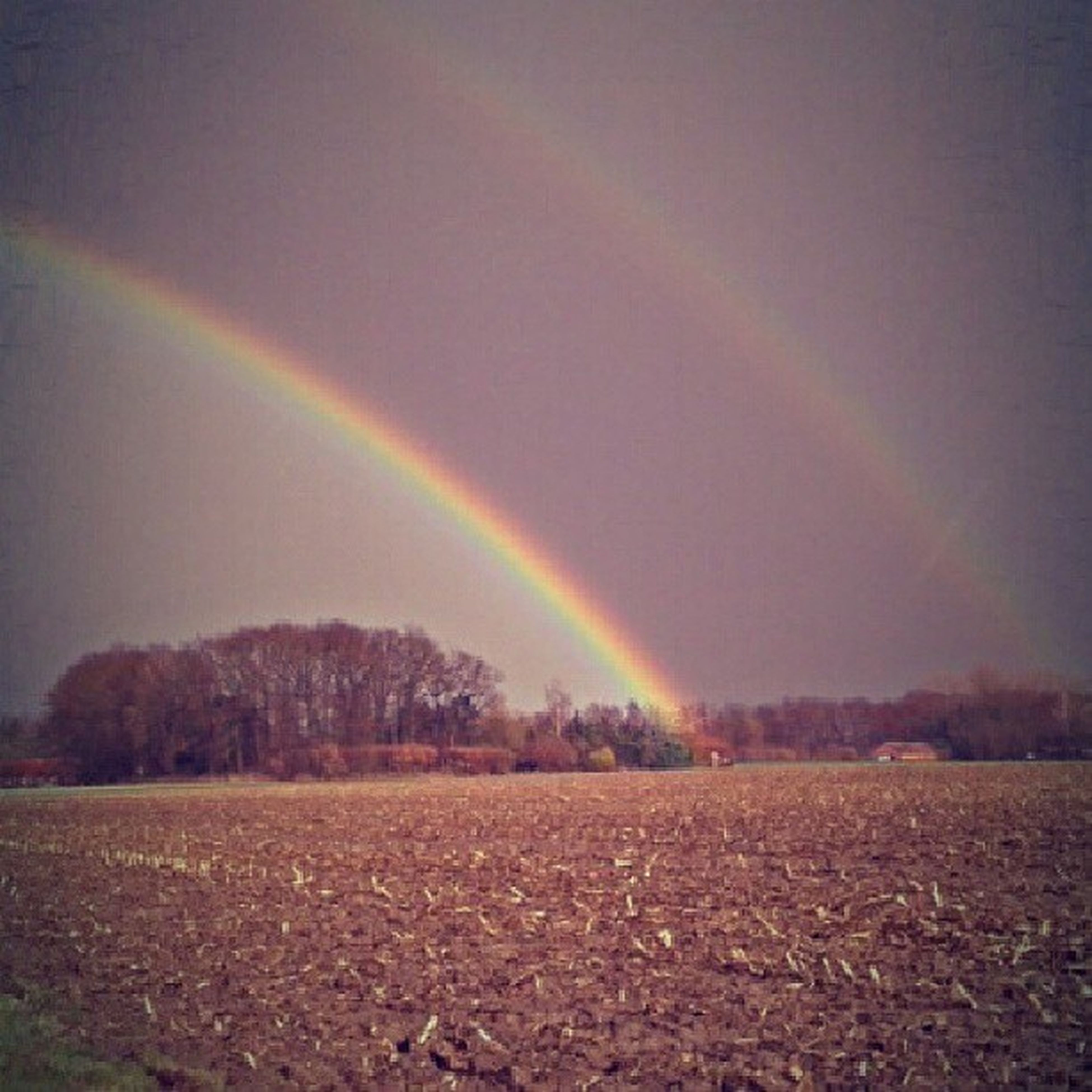 scenics, rainbow, sky, tranquil scene, landscape, multi colored, beauty in nature, tranquility, nature, idyllic, cloud - sky, non-urban scene, outdoors, no people, field, night, remote, mountain, weather, dramatic sky