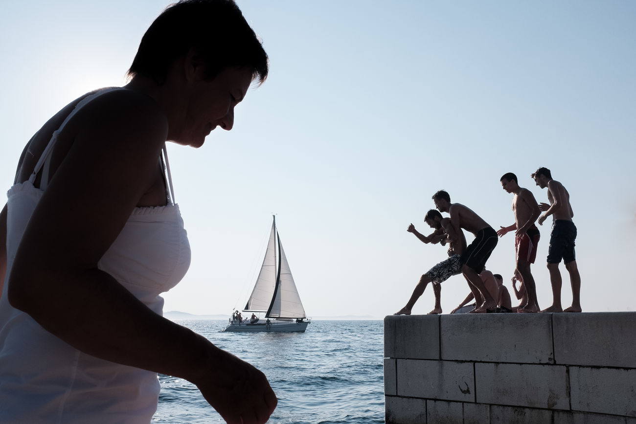 Scene at the promenade in Zadar. Adriatic Adult Beach Boat Croatia Day Horizon Over Water Horizontal Men Mythology Nature Nautical Vessel Outdoors People Person Sailing Streetphotography Street Photography Sea Silhouette Travel Vacations Woman Young Adult Zadar