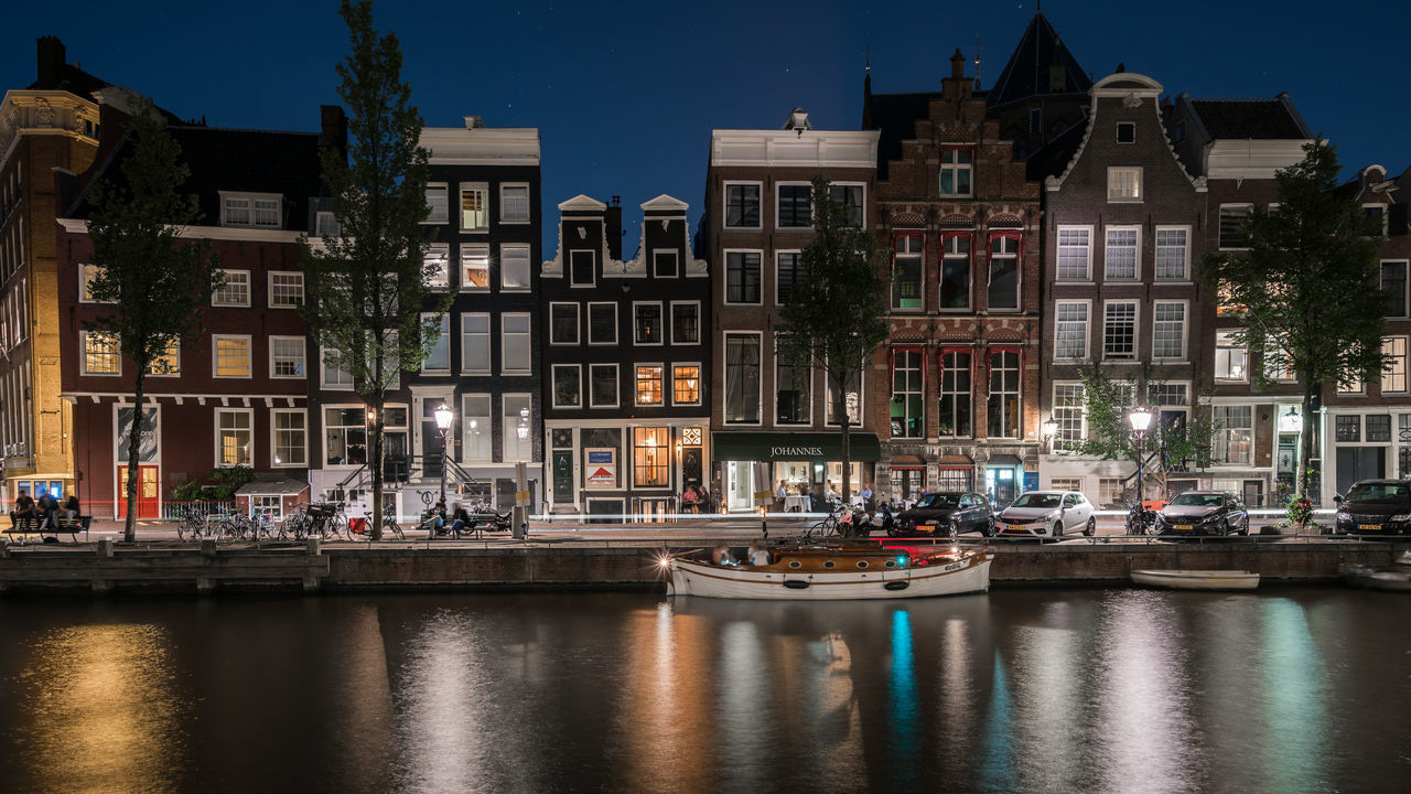 Amsterdam Nights Amsterdam Architecture Boat Canal Canal Houses Capital Cities  City City Life Classic Dutch Enjoying The View Europe Holland Keizersgracht Lights Long Exposure Netherlands Night Night Life Nightphotography Outdoors Reflection Slow Shutter UNESCO World Heritage Site Water