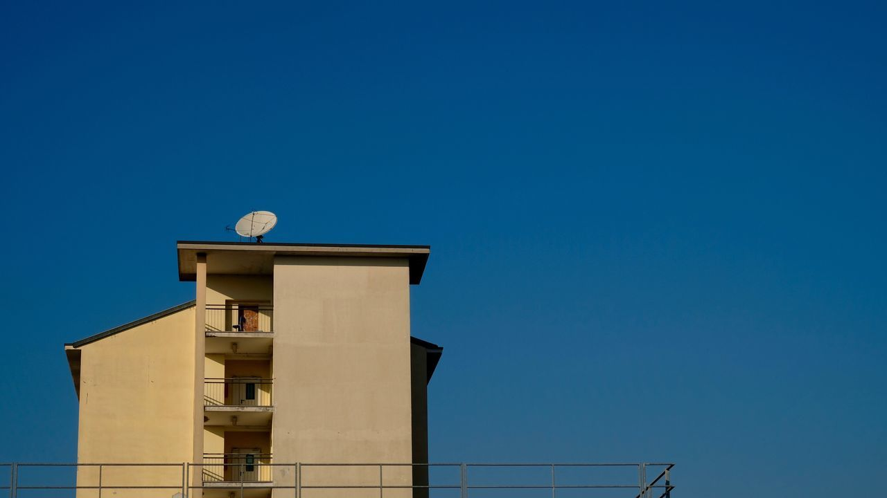 built structure, copy space, architecture, clear sky, blue, building exterior, moon, low angle view, outdoors, day, no people, sky, nature, beauty in nature