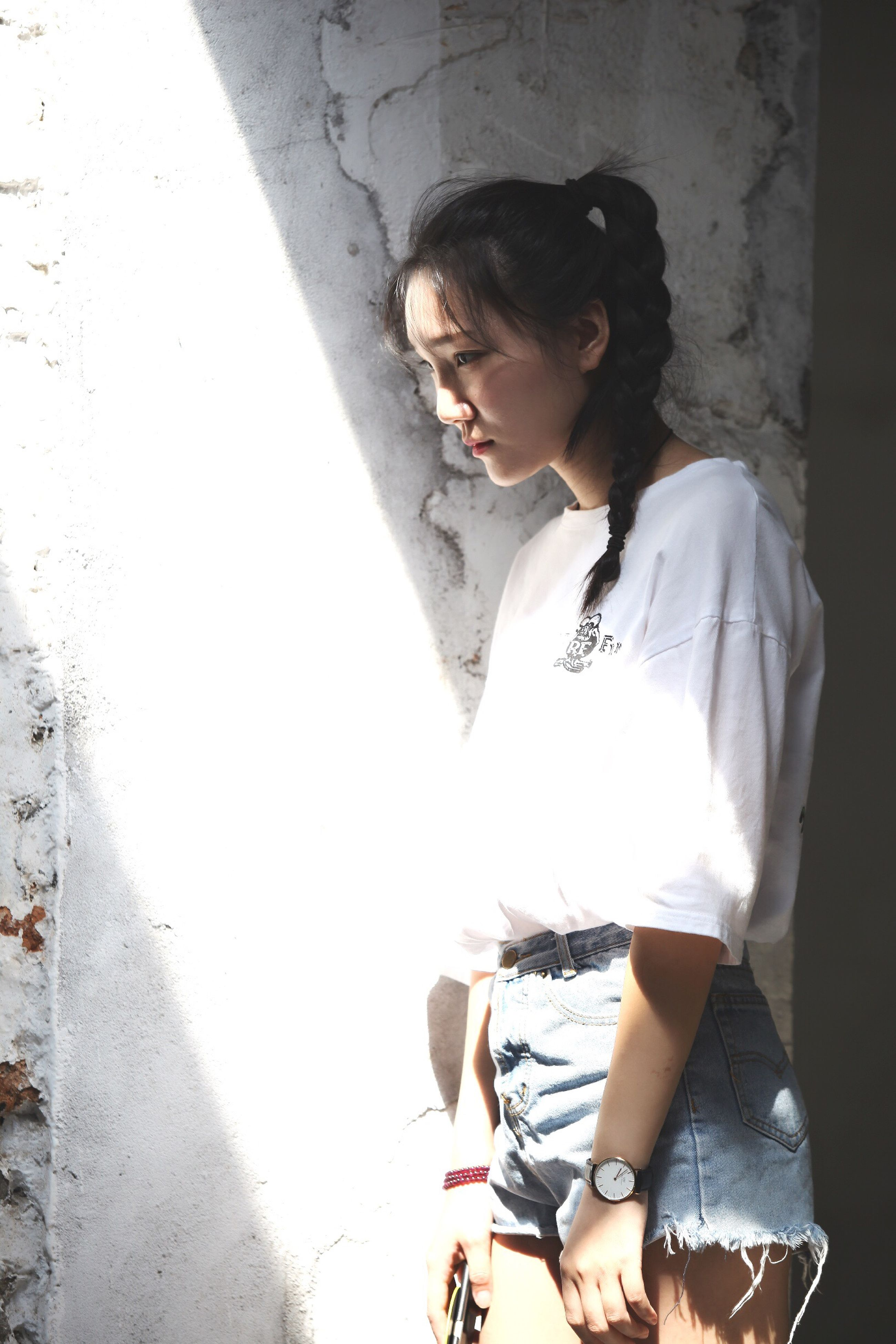 casual clothing, standing, sunglasses, young adult, person, youth culture, confidence, fashionable
