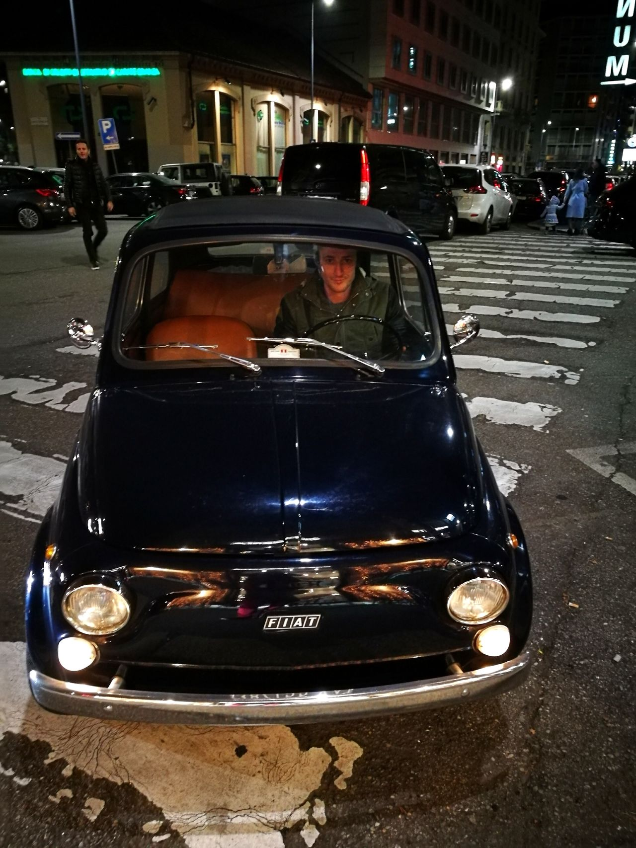 Car Adults Only Transportation Land Vehicle Adult Front View People One Person Men Night City Outdoors Vintage Cars Old Style Dark Blue City Car Small Car Transportation Exploring Style