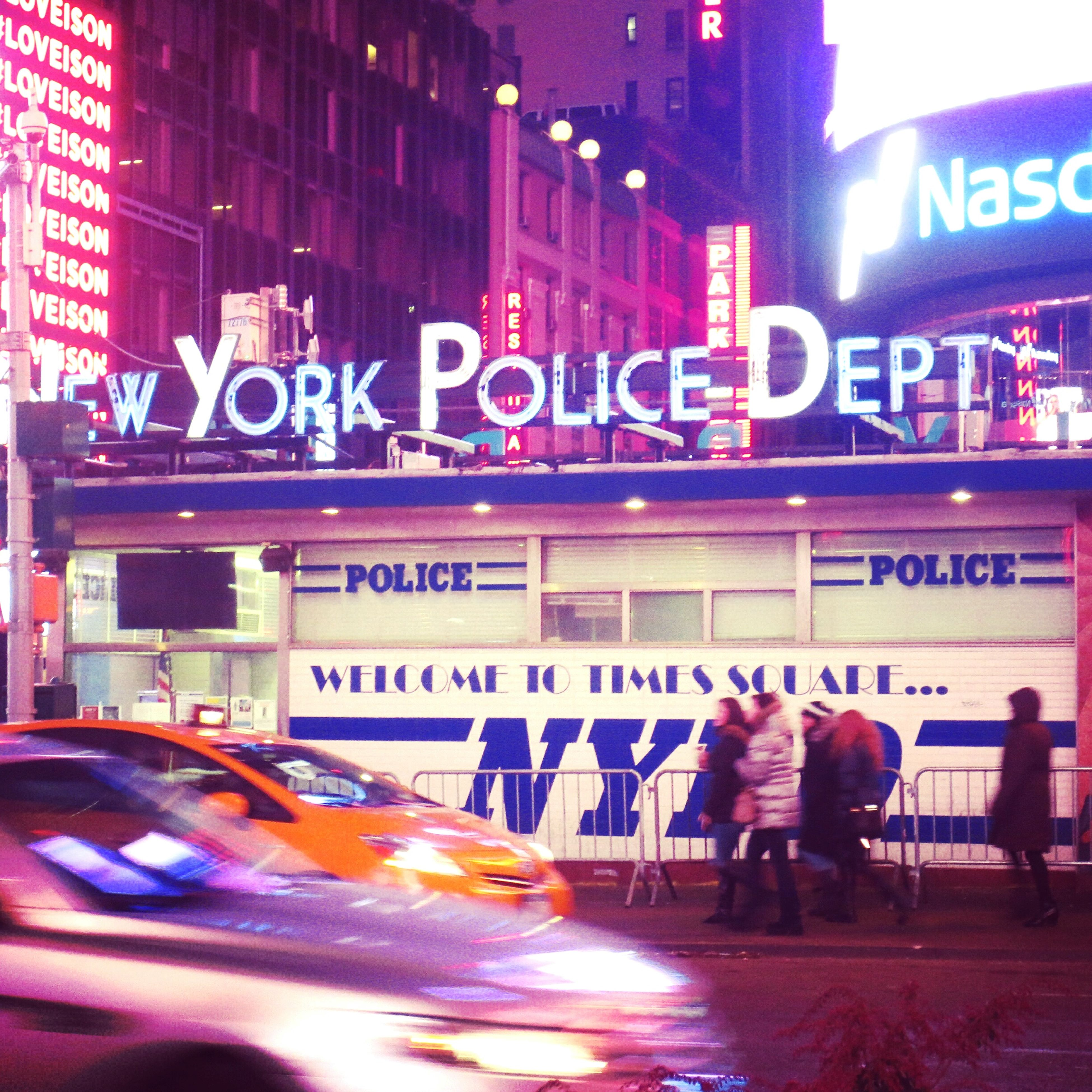 text, western script, architecture, built structure, communication, building exterior, city, illuminated, street, men, non-western script, night, transportation, city life, person, sign, information sign, lifestyles, blurred motion