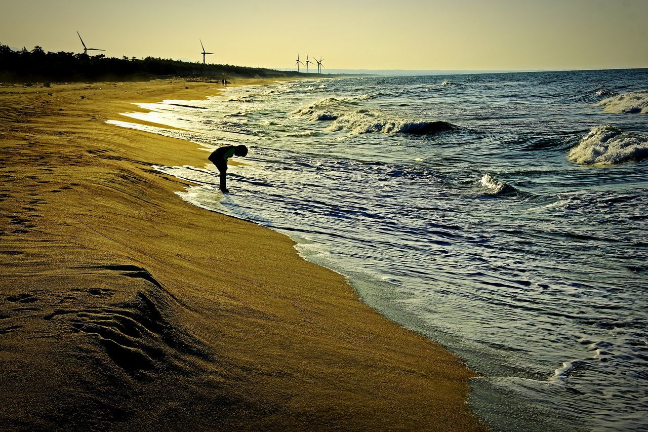 City Life Bird People One Person will not forget Sunset Sea Sand Beauty In Nature Nature Outdoors Water Sky Gold Colored Shoes wet Real People Wave DayMarch11