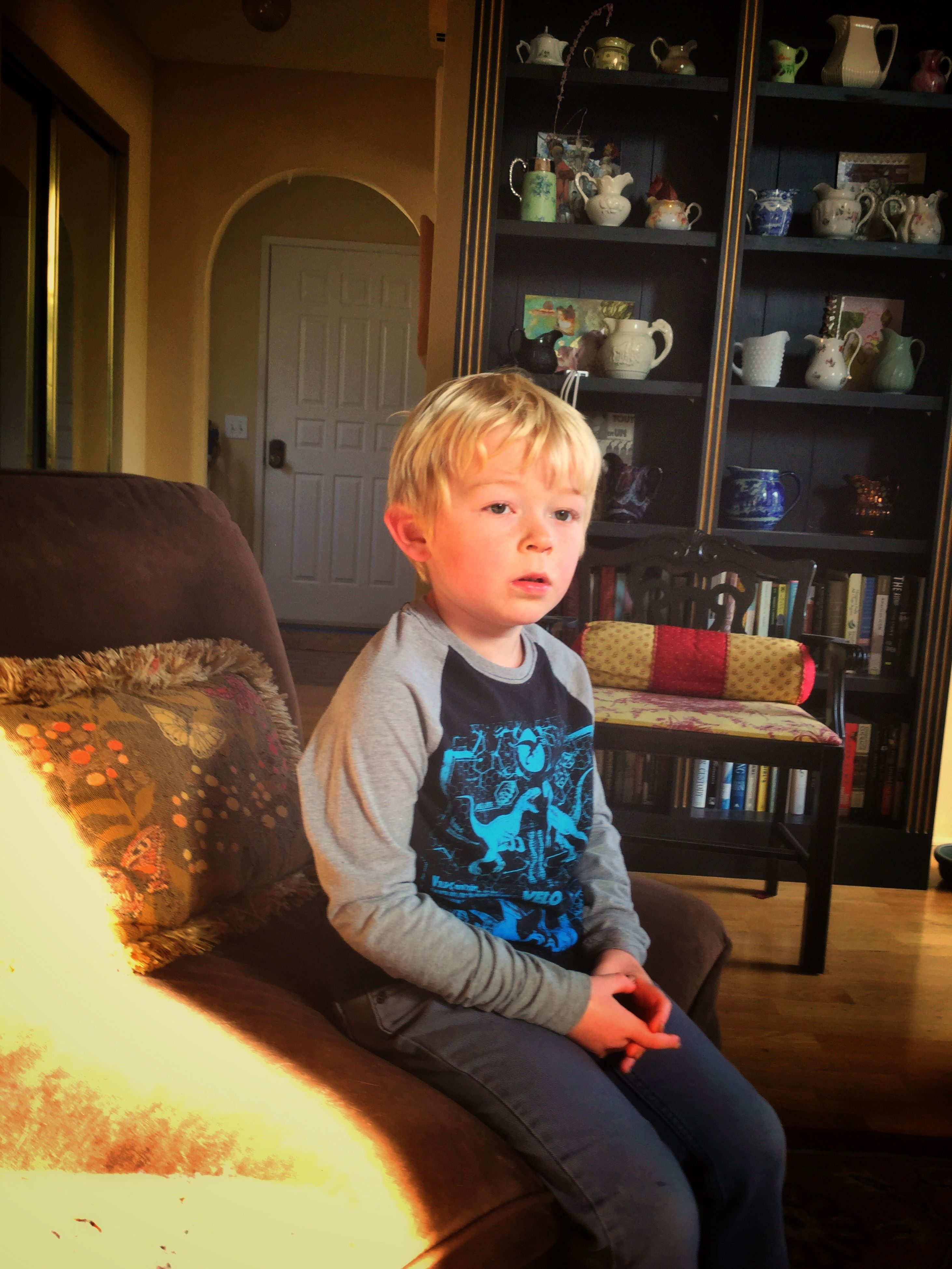 sitting, three quarter length, child, childhood, blond hair, people, one person, portrait, indoors, children only, day