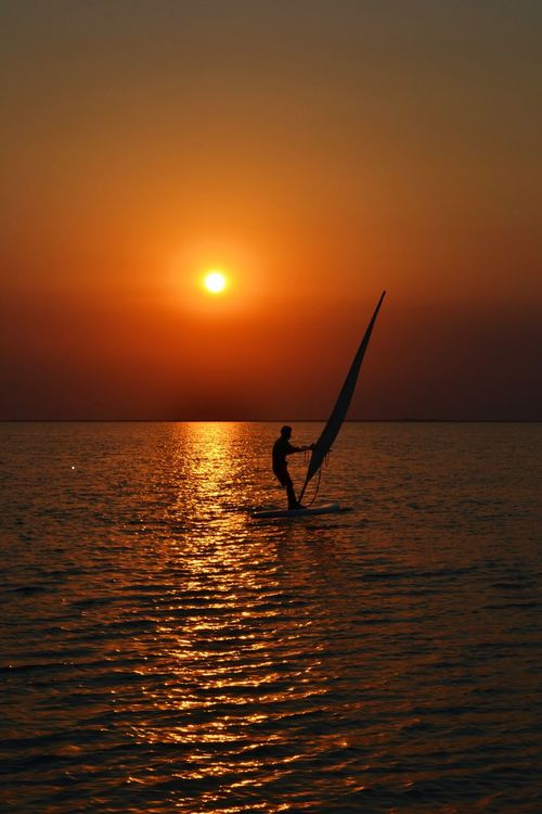 Sunset and surf romantic Nature Balance People Sun Sunset Sea One Person Adventure Sport Vacations Silhouette Water Achievement Dream Romantic Love Horizont