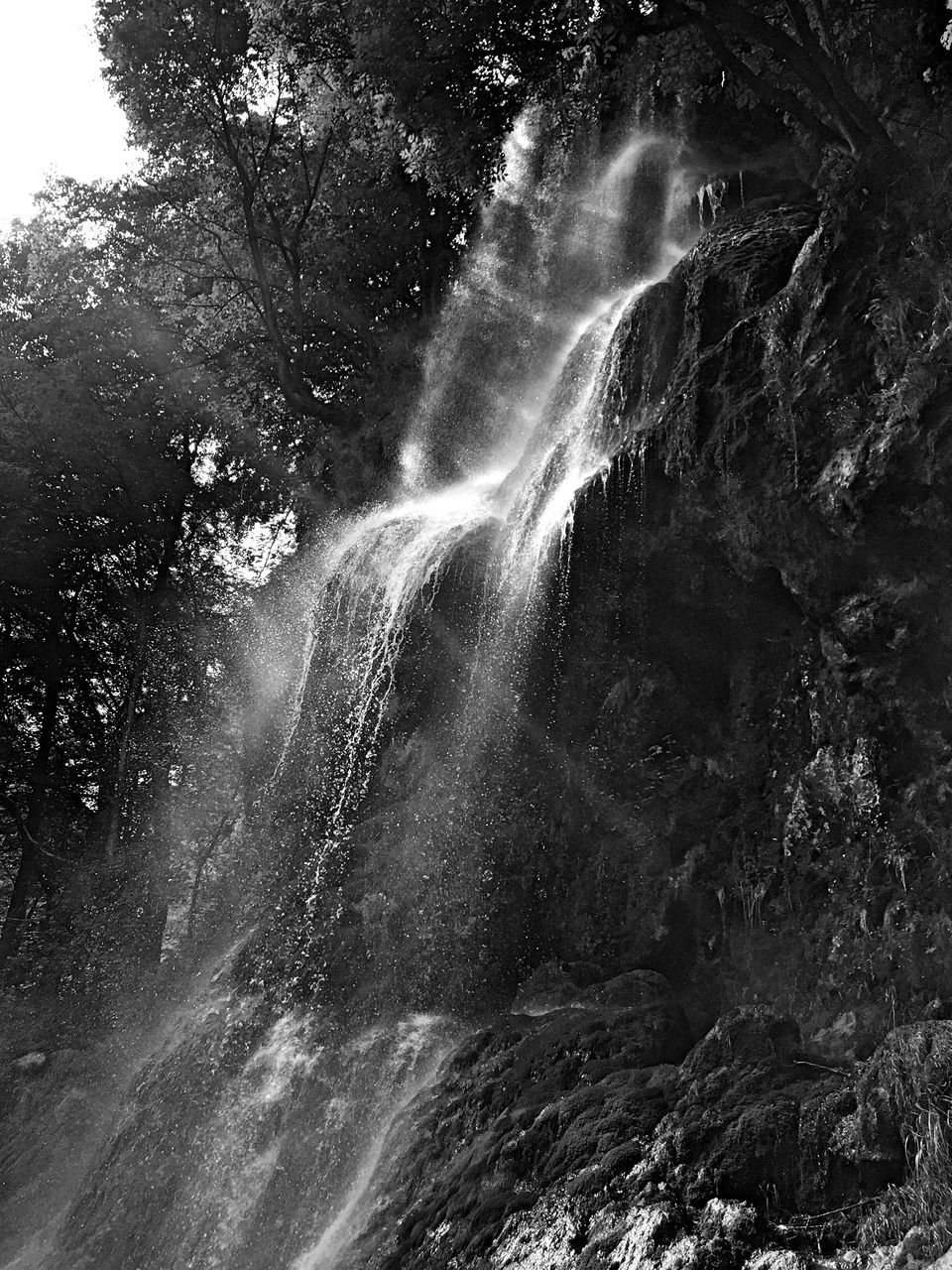 waterfall, motion, water, scenics, long exposure, beauty in nature, nature, rock - object, power in nature, tranquil scene, no people, outdoors, day, tree, freshness, sky