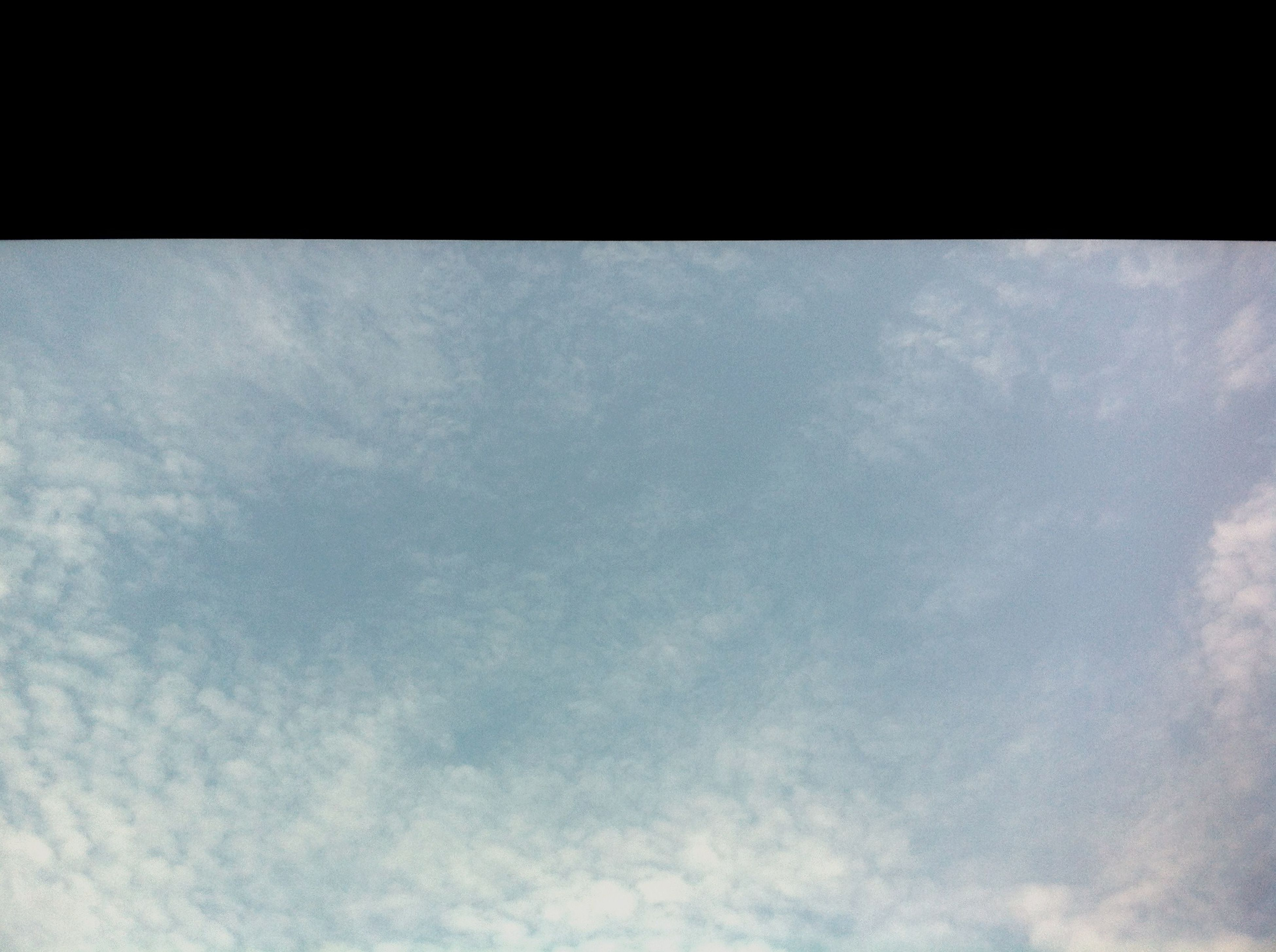low angle view, sky, transfer print, cloud - sky, beauty in nature, tranquility, nature, auto post production filter, backgrounds, scenics, tranquil scene, cloudy, cloud, full frame, no people, sky only, day, outdoors, copy space, white color
