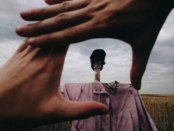 A scarecrow in a Handframe Scarecrow Field Village
