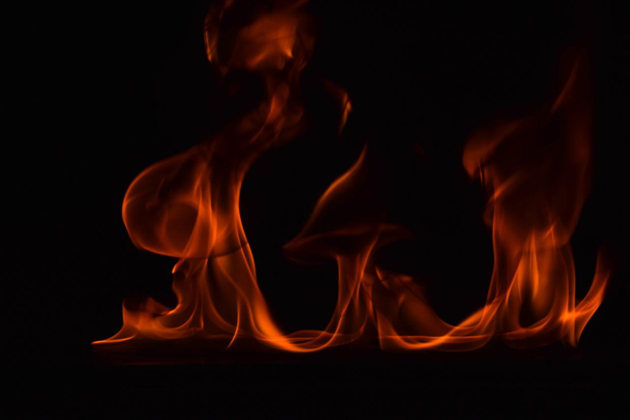 burning, fire - natural phenomenon, flame, heat - temperature, orange color, danger, motion, glowing, close-up, night, smoke - physical structure, black background, no people, bonfire, studio shot, indoors