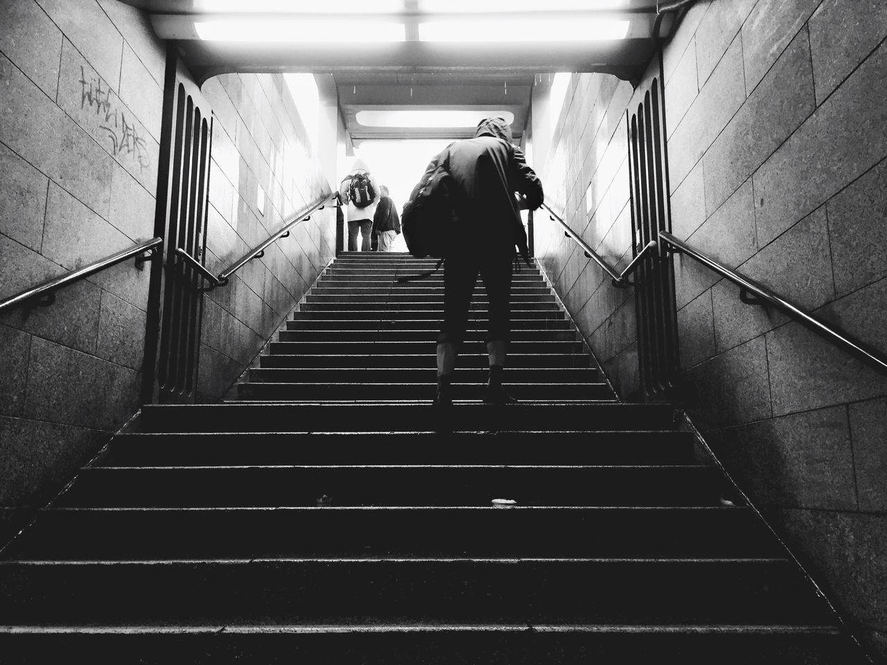 Staircase Steps Steps And Staircases Stairs Walking Lifestyles Stairs Men Architecture Illuminated Urban Underground Underground Station  Dark Darkness And Light Moody Rain Depressed Indoors  Low Angle View Berlin Black And White Blackandwhite Black & White One Person EyeEm Selects Let's Go. Together.