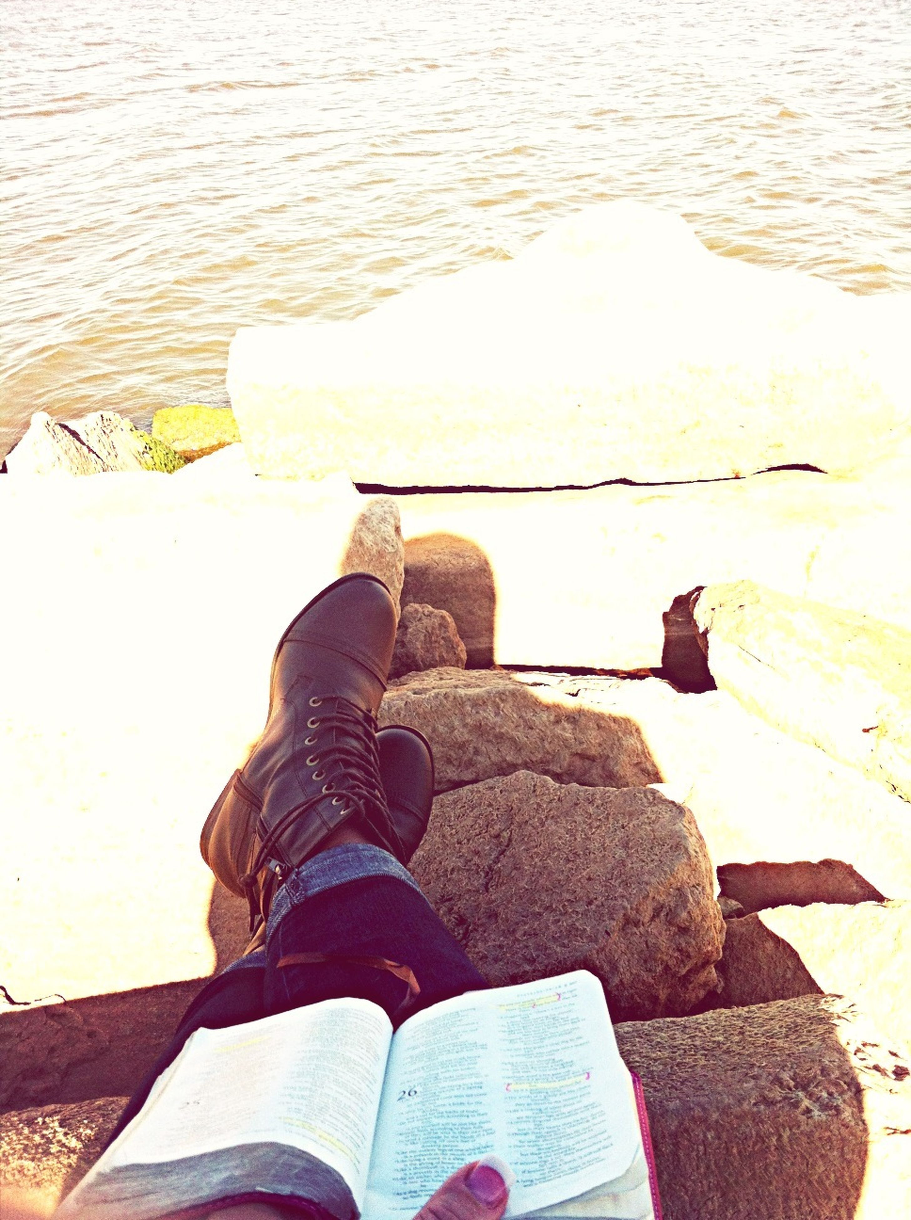 water, high angle view, low section, person, lifestyles, personal perspective, shoe, standing, leisure activity, men, sea, human foot, footwear, day, lake, unrecognizable person, relaxation, outdoors