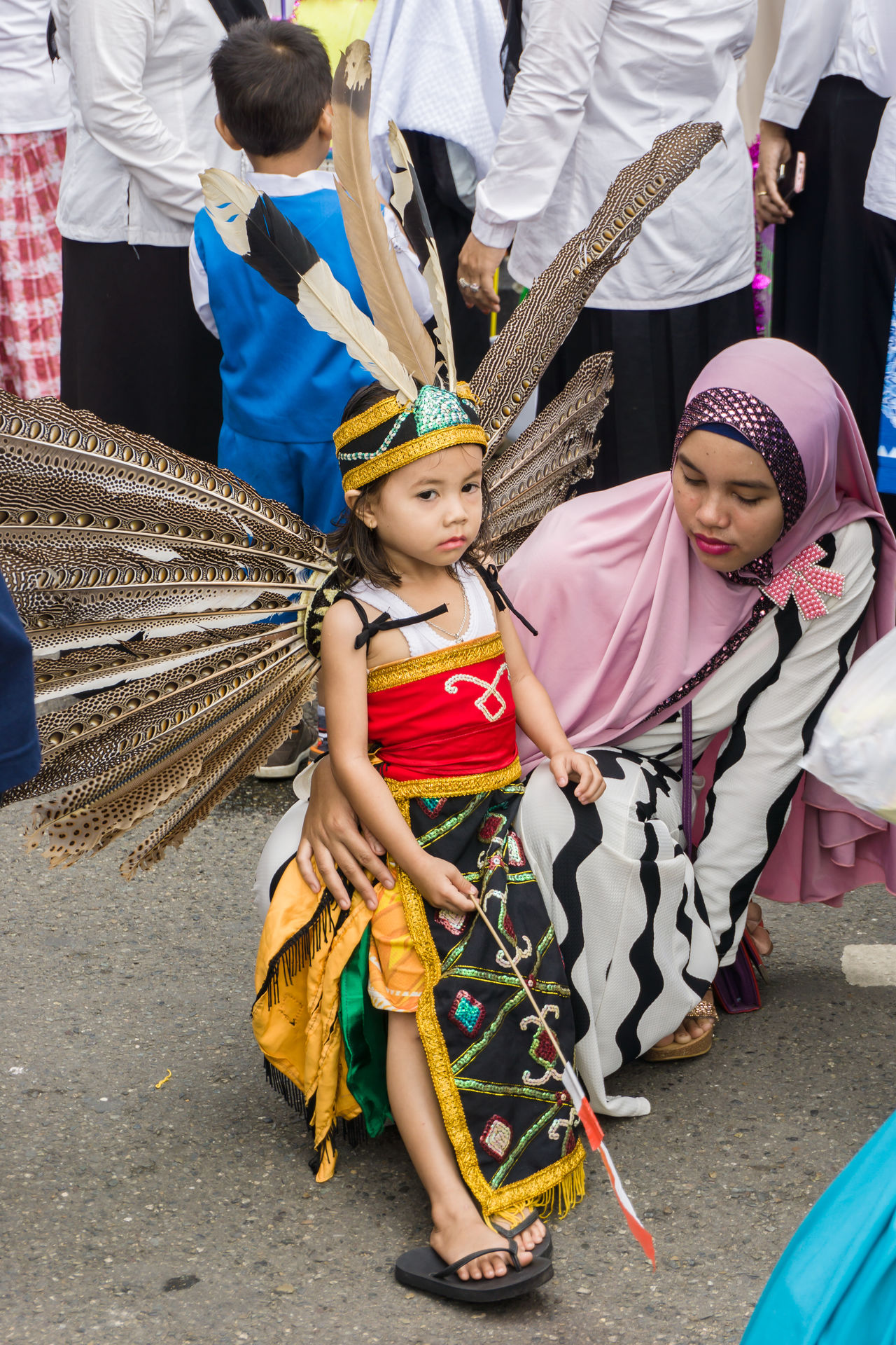 Dayak tribe clothing at kindergarten carnival Adult Carnival Crowds And Details Child Childhood Day Dayak Costume EyeEmNewHere Full Length Girls Kindergarten Looking At Camera Mother Mother And Daughter Outdoors People Portrait Standing Street Photography Traditional Clothing Brazil Carnival Crowds