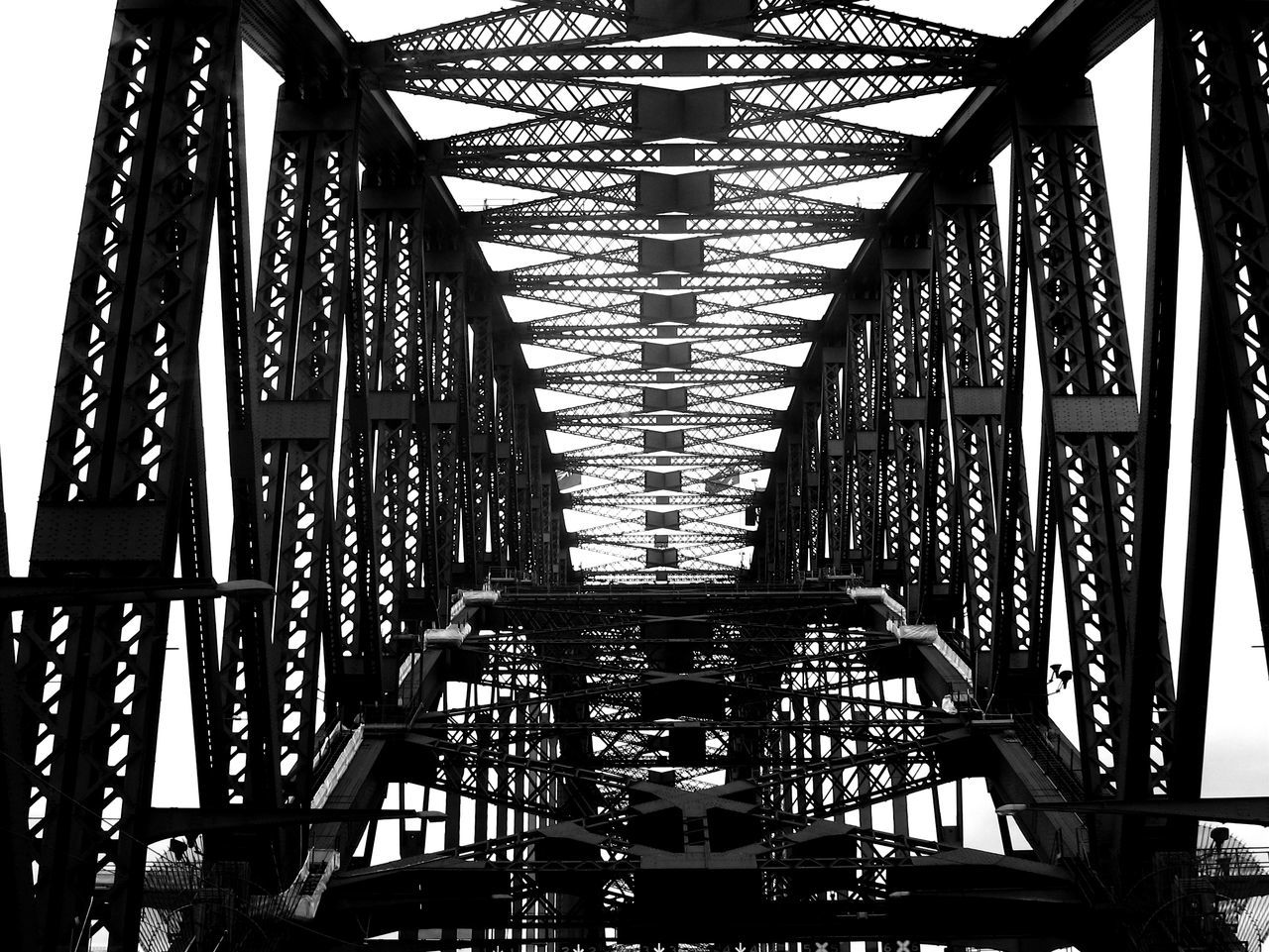 bridge - man made structure, built structure, connection, metal, architecture, low angle view, day, no people, indoors, girder