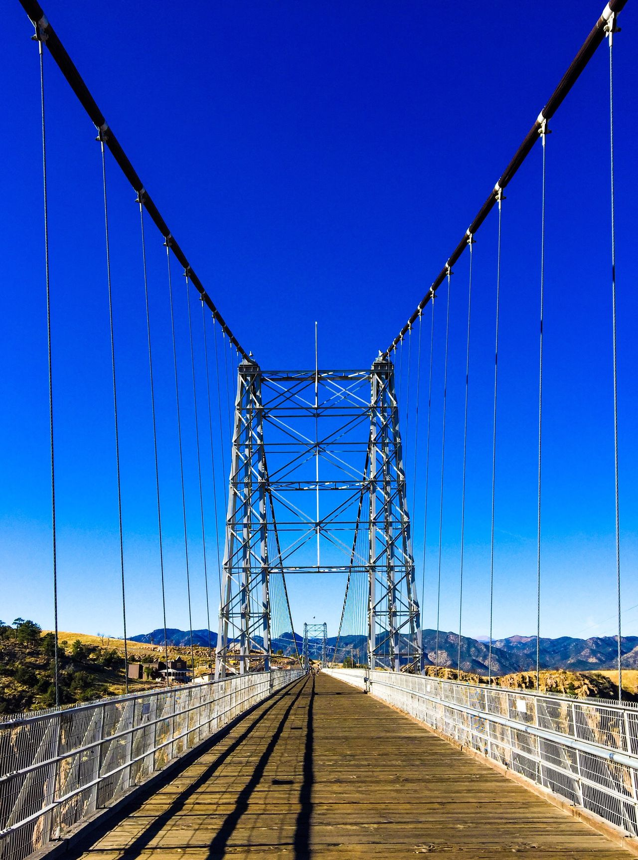 The Royal Gorge Bridge. Total length is 1,260 feet. It's 18 feet wide and 955 feet above the gorge floor. Check This Out Taking Photos Travel Photography Photography Architecture_collection Bridge Colorado Attraction Pedestrian Bridge Visit Colorado