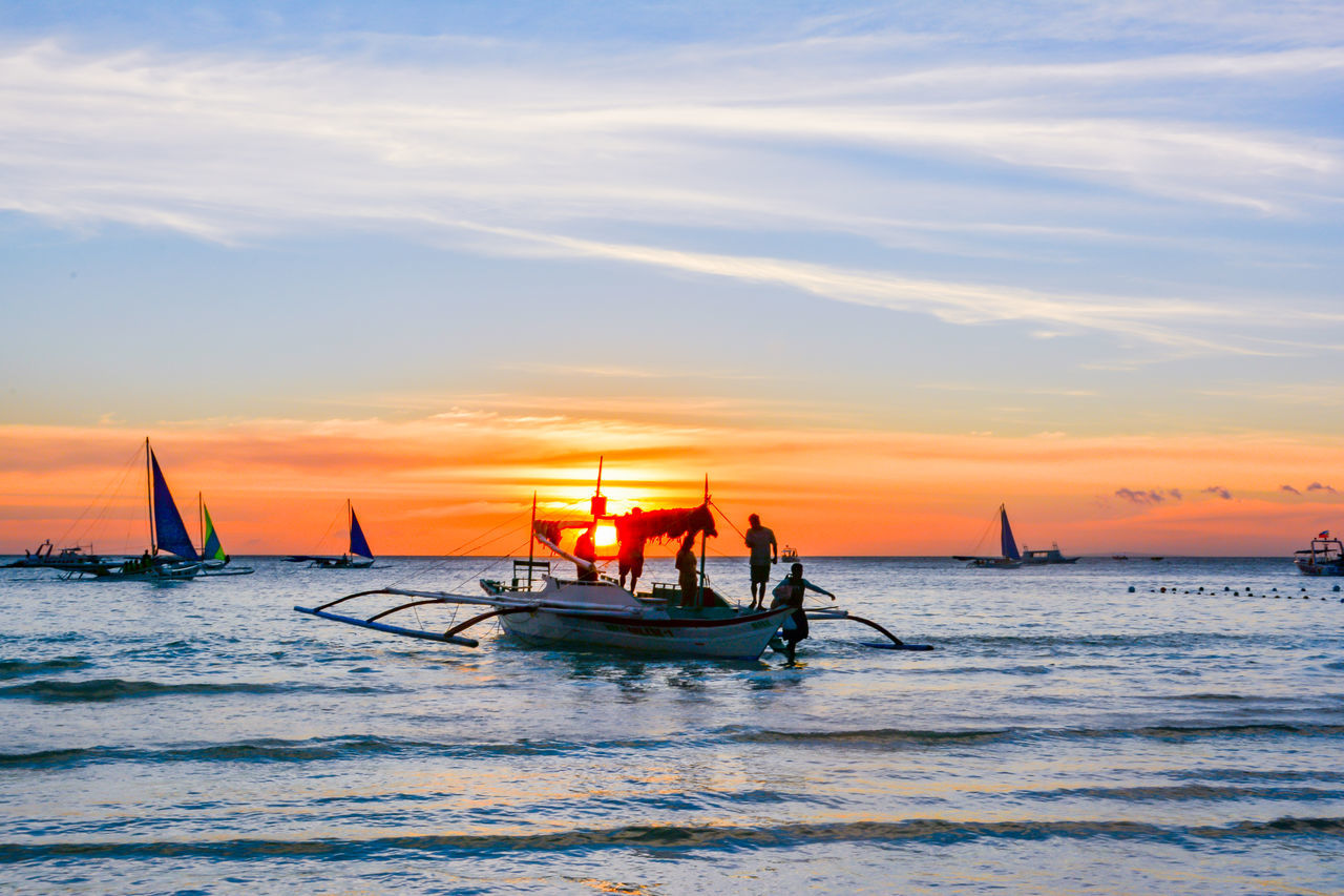 sea, sunset, water, nautical vessel, sky, beauty in nature, transportation, nature, scenics, orange color, mode of transport, cloud - sky, horizon over water, tranquility, tranquil scene, waterfront, outdoors, outrigger, longtail boat, beach, real people, jet boat, day