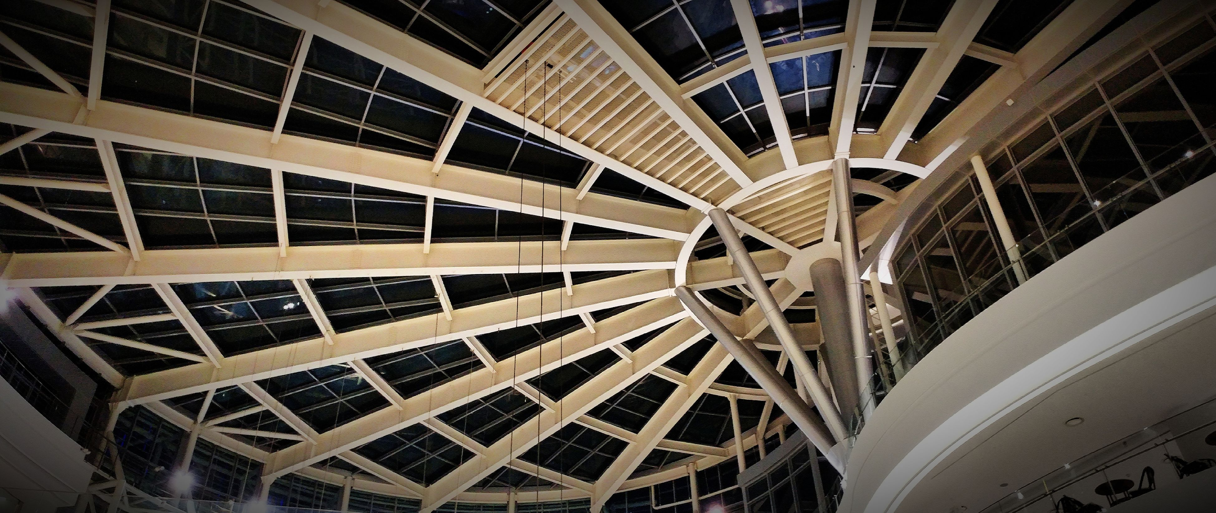 architecture, built structure, building exterior, low angle view, architectural feature, indoors, famous place, modern, city, capital cities, travel destinations, international landmark, ceiling, arch, travel, building, tourism, day, bridge - man made structure, pattern