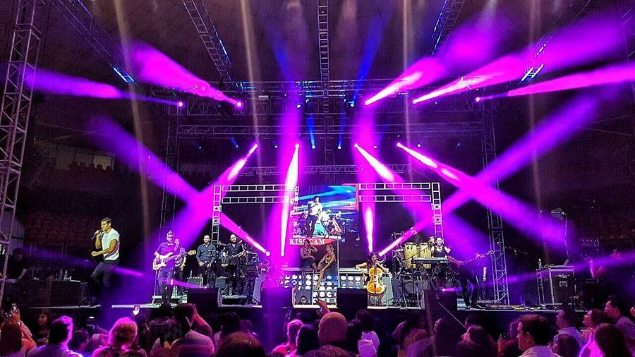 Large Group Of People Crowd Illuminated Arts Culture And Entertainment Nightlife Enjoyment Music Person Performance Lifestyles Togetherness Fun Multi Colored Event Leisure Activity Night Concert Popular Music Concert Men Stage - Performance Space