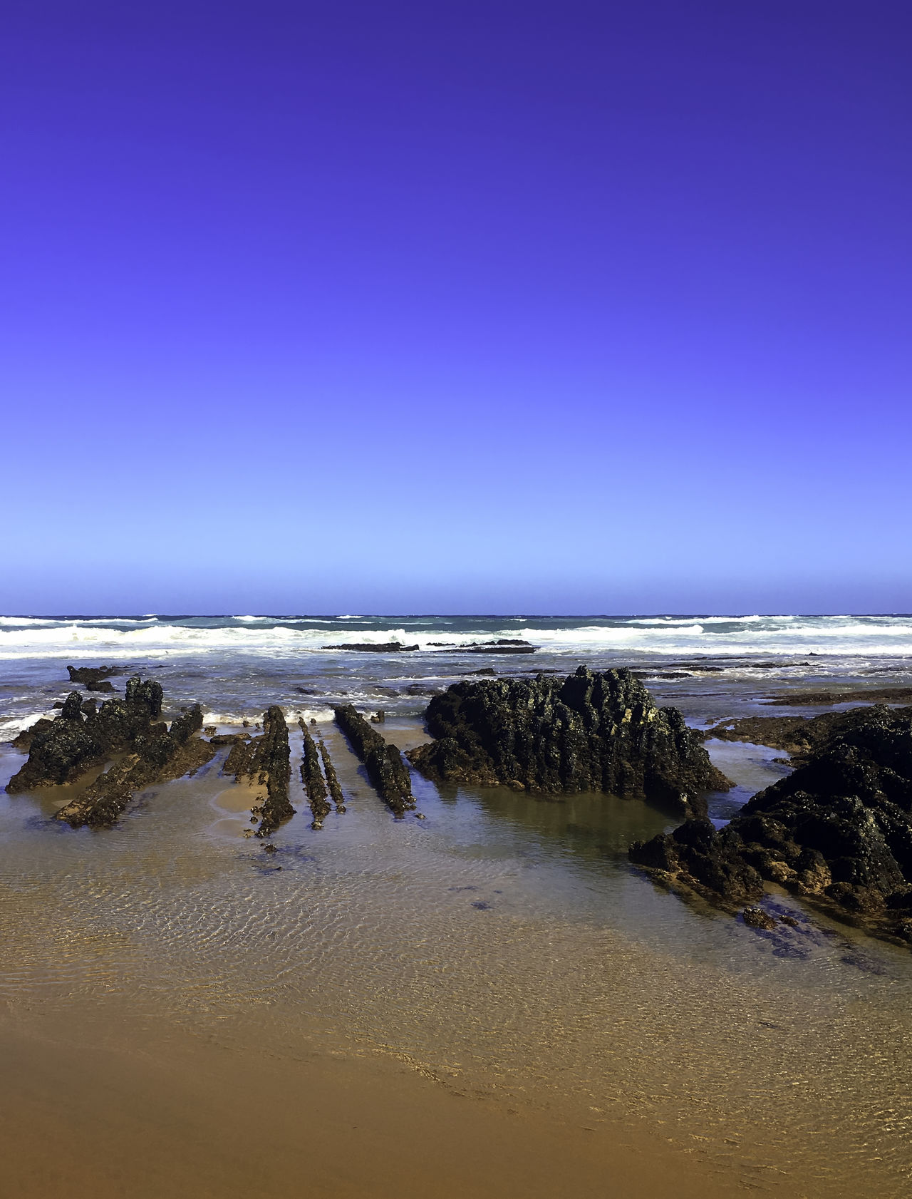 Fels am Strand Al Aljezur Beach Beauty In Nature Blue Clear Sky Coastal Feature Horizon Over Water Idyllic Majestic Nature Portugal Rocks Sand Scenics Sea Seascape Shore Summer Tranquil Scene Travel Travel Destinations Vacations Water