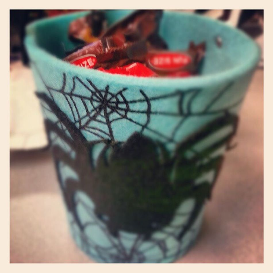 Halloween treats given to me by one of my students. So my co-workers will be very thrilled because I will be sharing goodies, but I'm keeping the tote. Lol